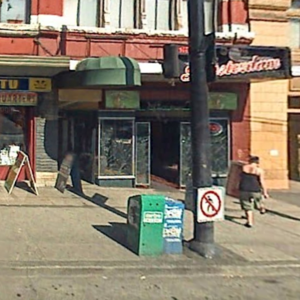 THIS IS THE GOOGLE STREET VIEW FROM 2007 OF THE NEW AMSTERDAM CAFE. ON THE LEFT, NEXT TO THE BLACK SANDWICH BOARD, THAT'S THE DOOR.
