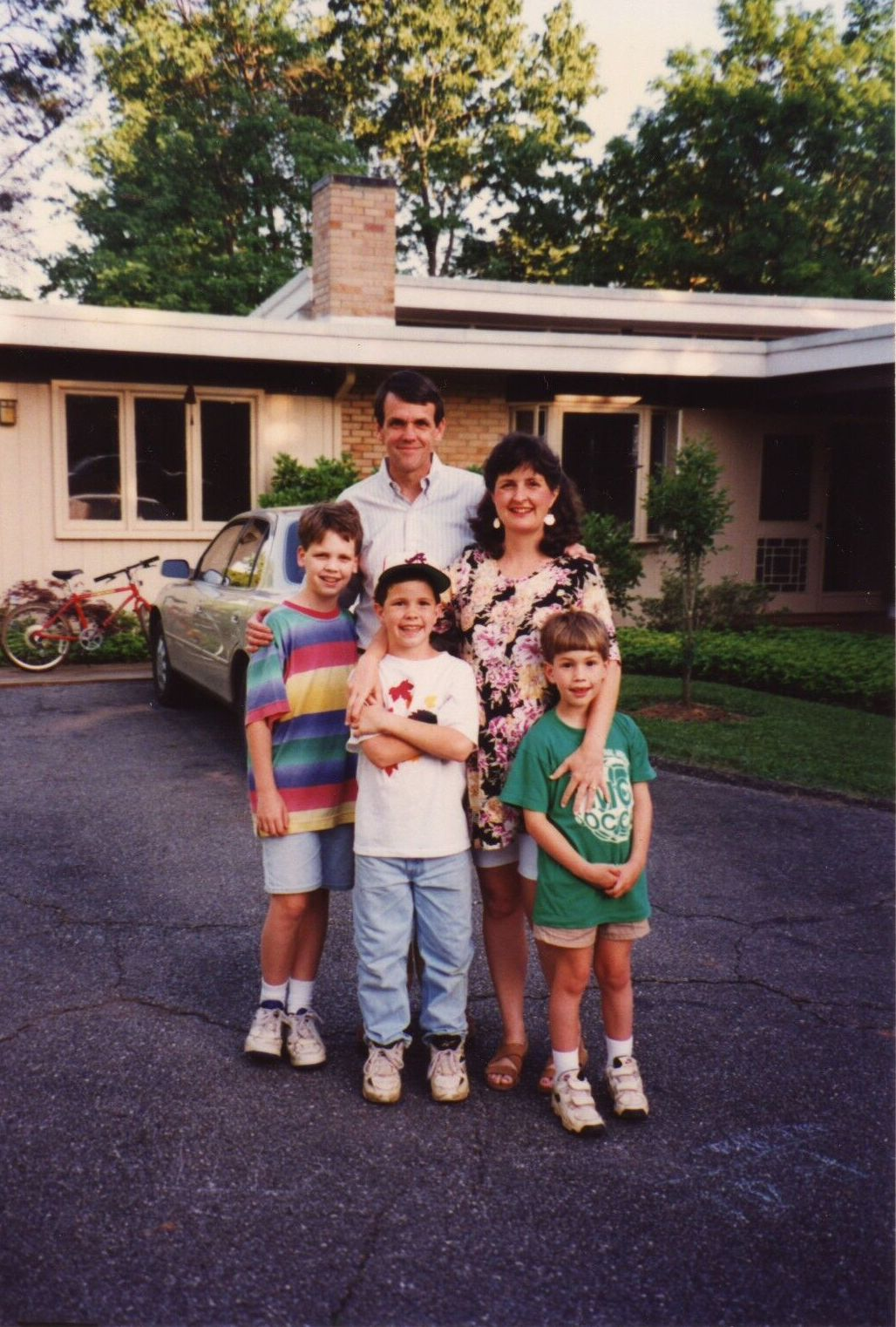 My family, circa 1995, a few months before the arrival of my youngest sibling, and only sister, Hope. That's me in the green, with the very trendy velcro shoes.