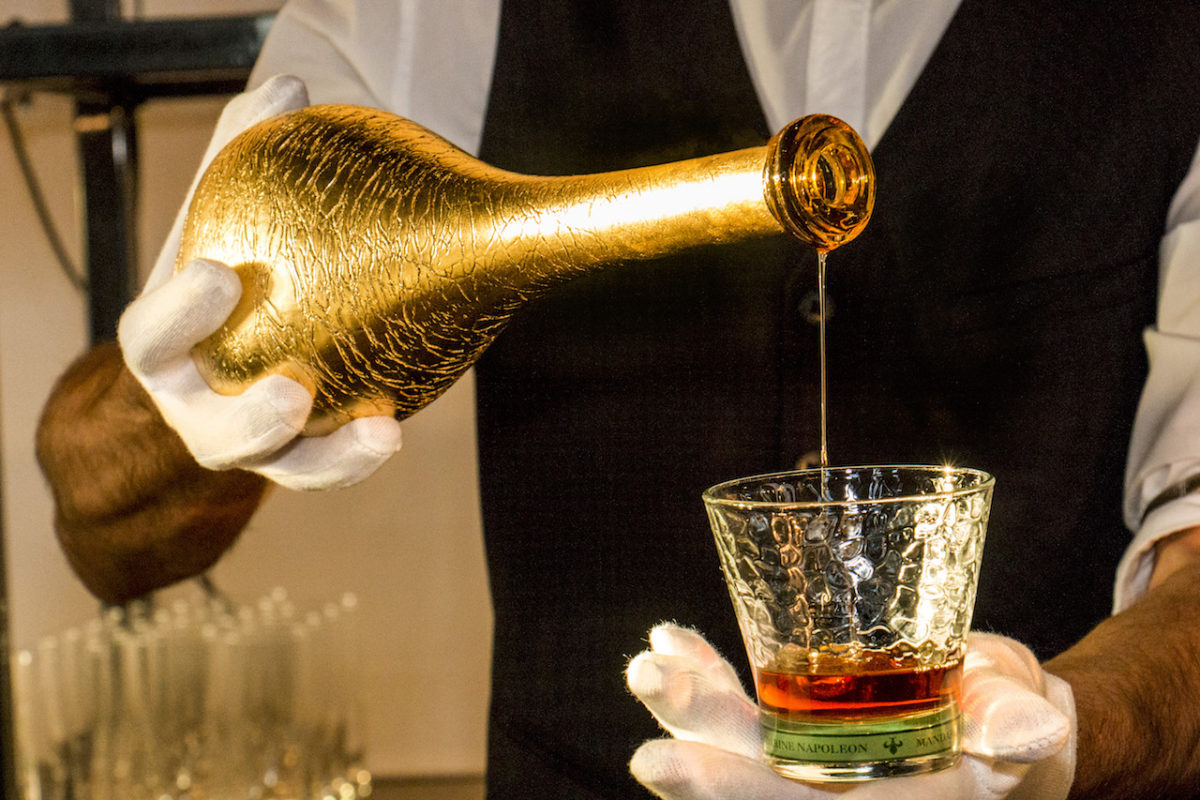 WE Toast Napoleon Bonaparte with a glass of his favorite orange liqueur. -