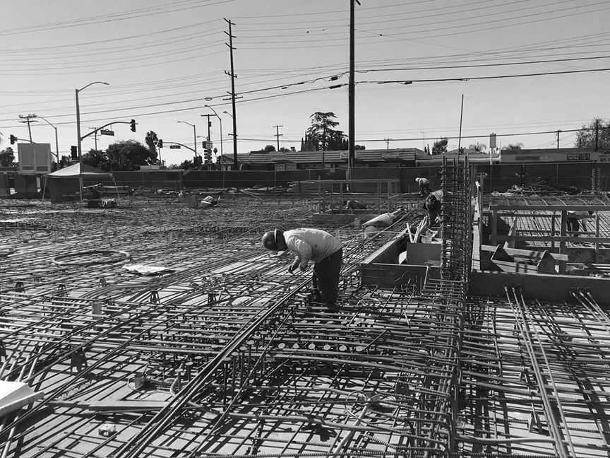 - Workers at the Palo Verde construction site in El Monte preparing the podium deck for concrete pour