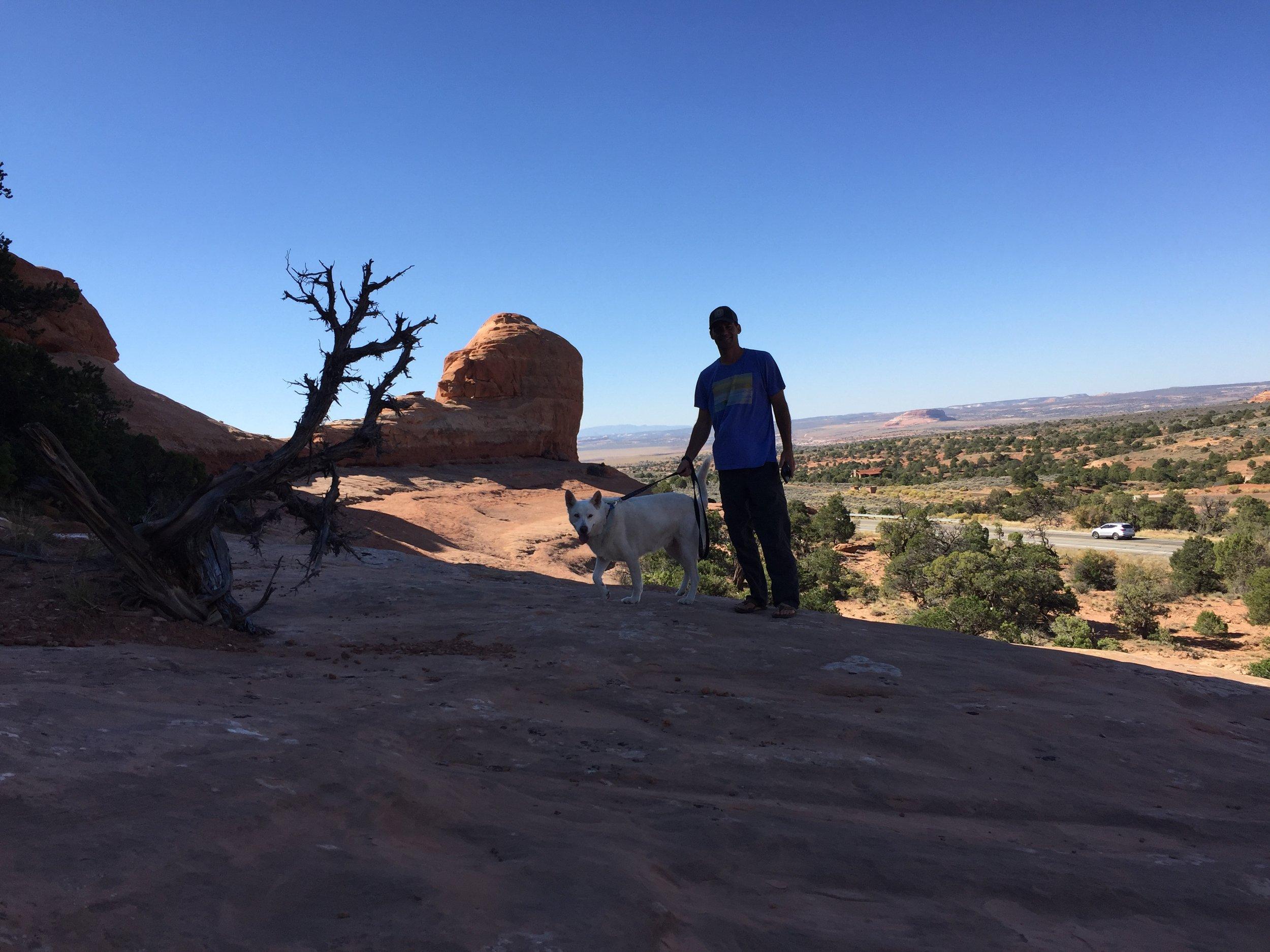 Brian and Mia climbing an arch rock