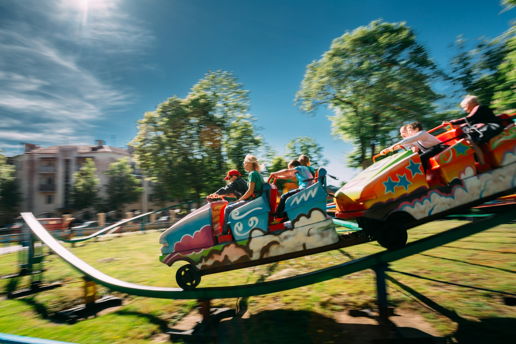 people-having-fun-on-rollercoaster-in-park-photo-PDZXJH7.jpg