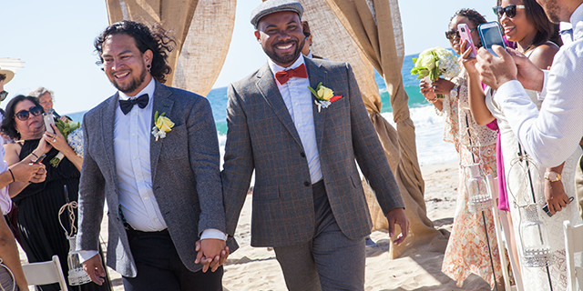 Newly-Married-Grooms-Walking-Down-The-Aisle.jpg