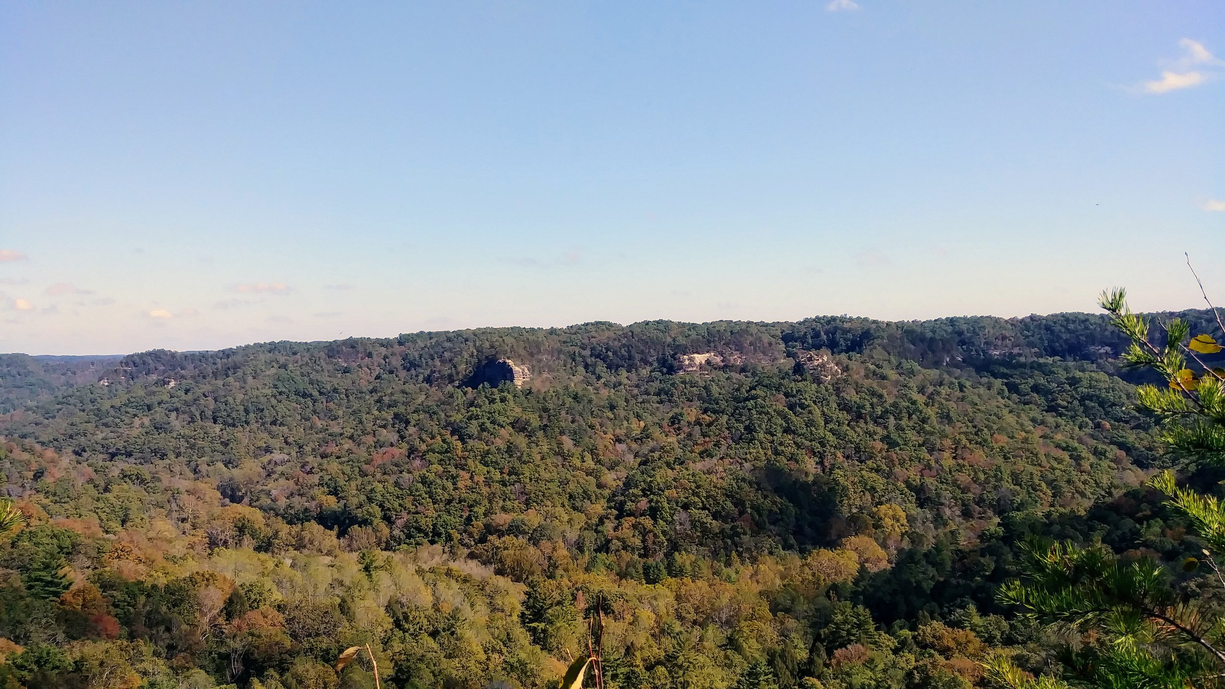Chimney Rock and Half Moon from a ledge at Pinch 'em Tight