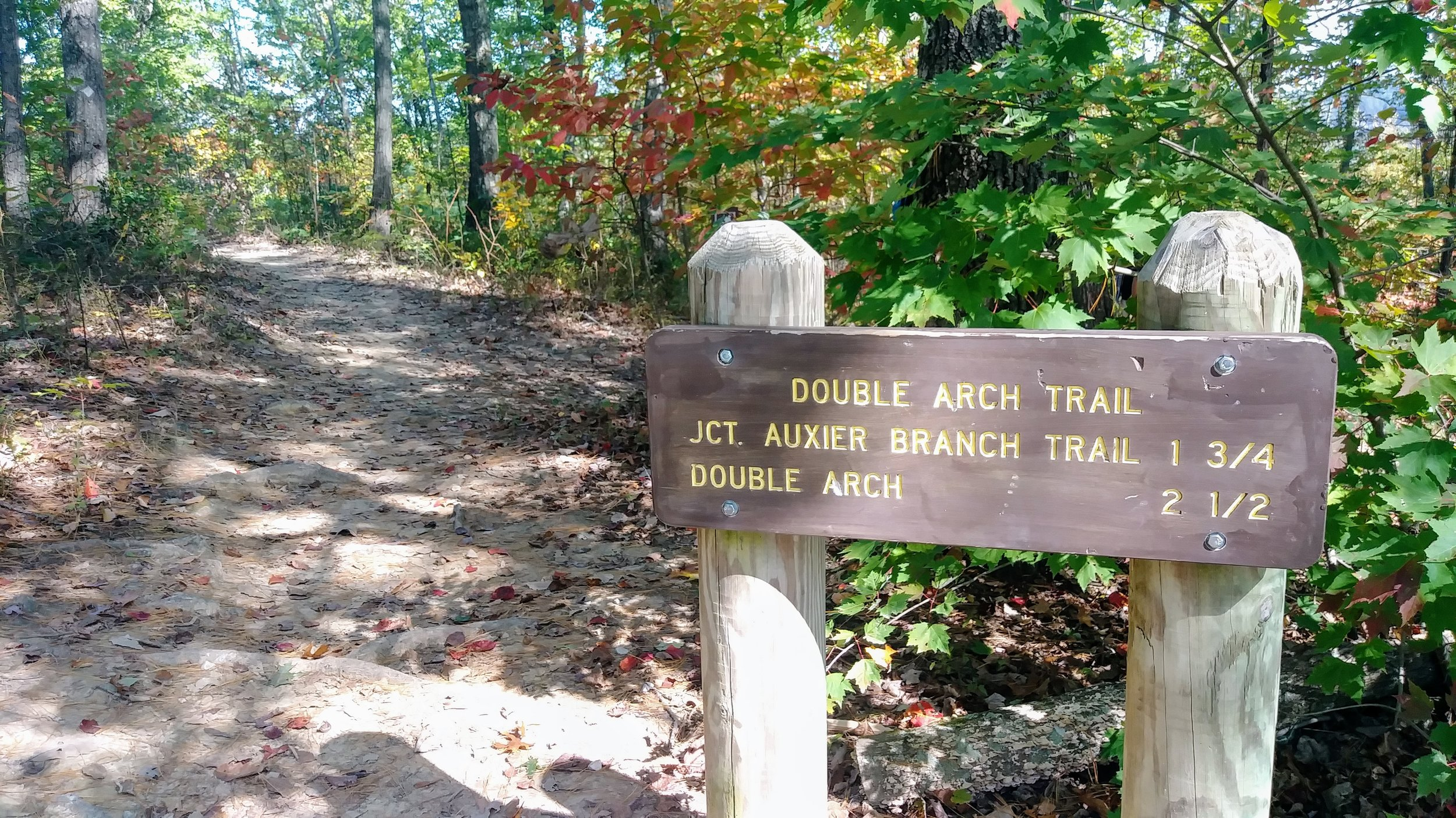 Signs at the Double Arch Trailhead.