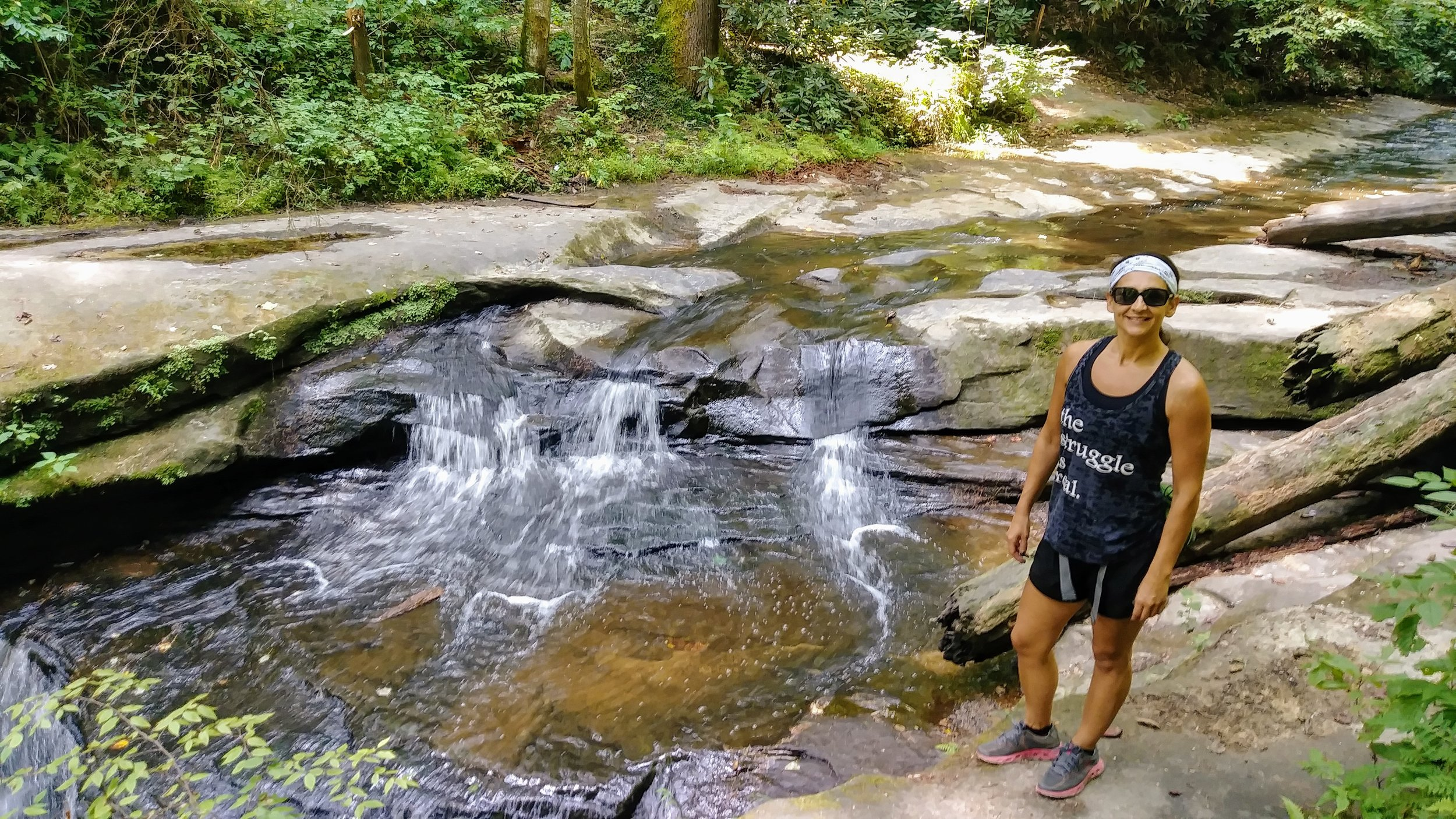 Standing next to the top of Creation Falls on Rock Bridge Trail