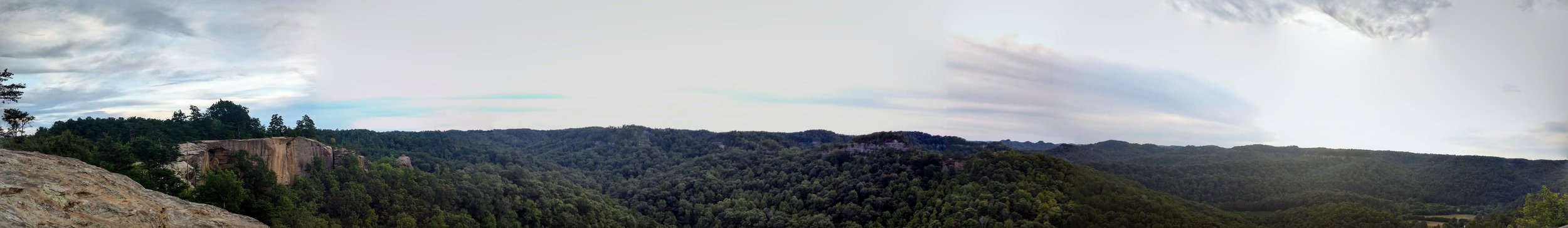 A full 180-degree view from Auxier Ridge looking out to Double Arch (center) and Red River Gorge (right)