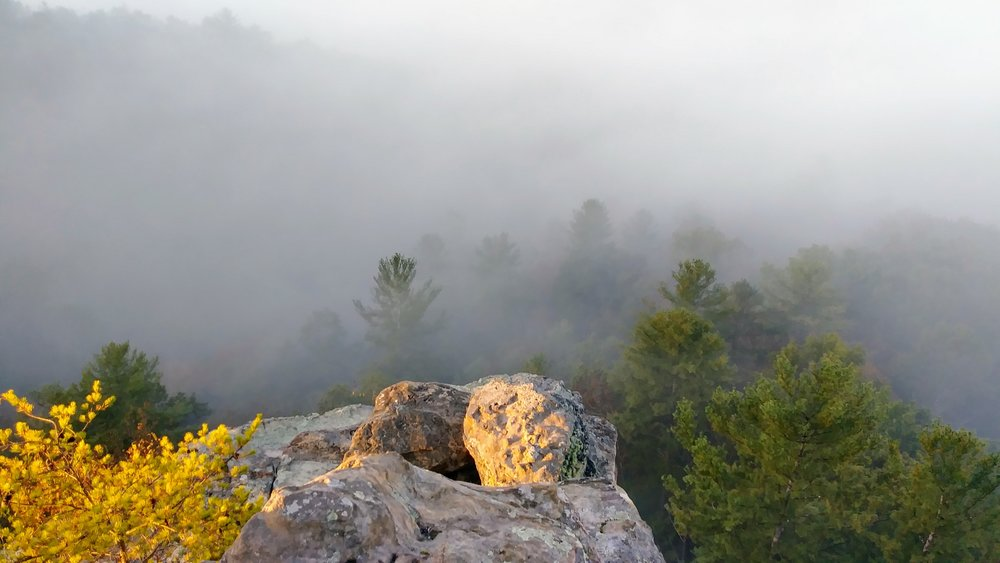 Sunrise at Chimney Top Rock - A short, mostly paved walk to the most iconic rock outcropping in Red River Gorge. Watch as the sun fills the gorge, lifting the morning fog bank to reveal pristine forest below.