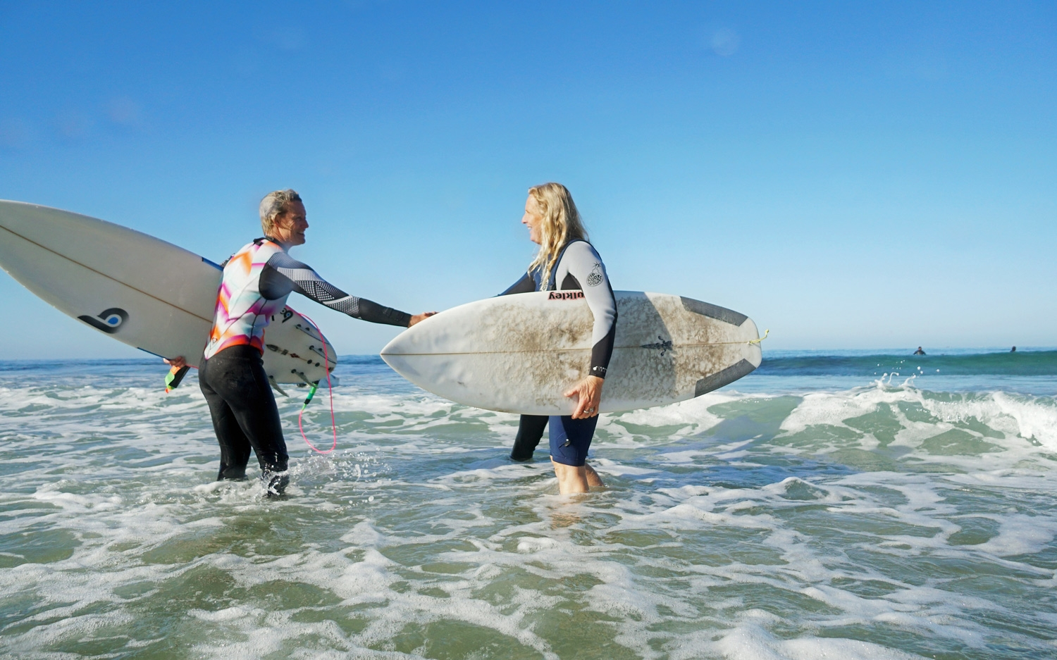 Our Expert Surf Coach Courtney (on the right) congratulating Deb for an awesome surf session!