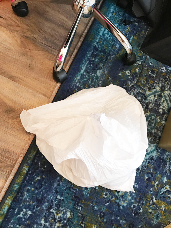 Have a big trash bag on hand so you can toss out obvious trash and old papers right on the spot