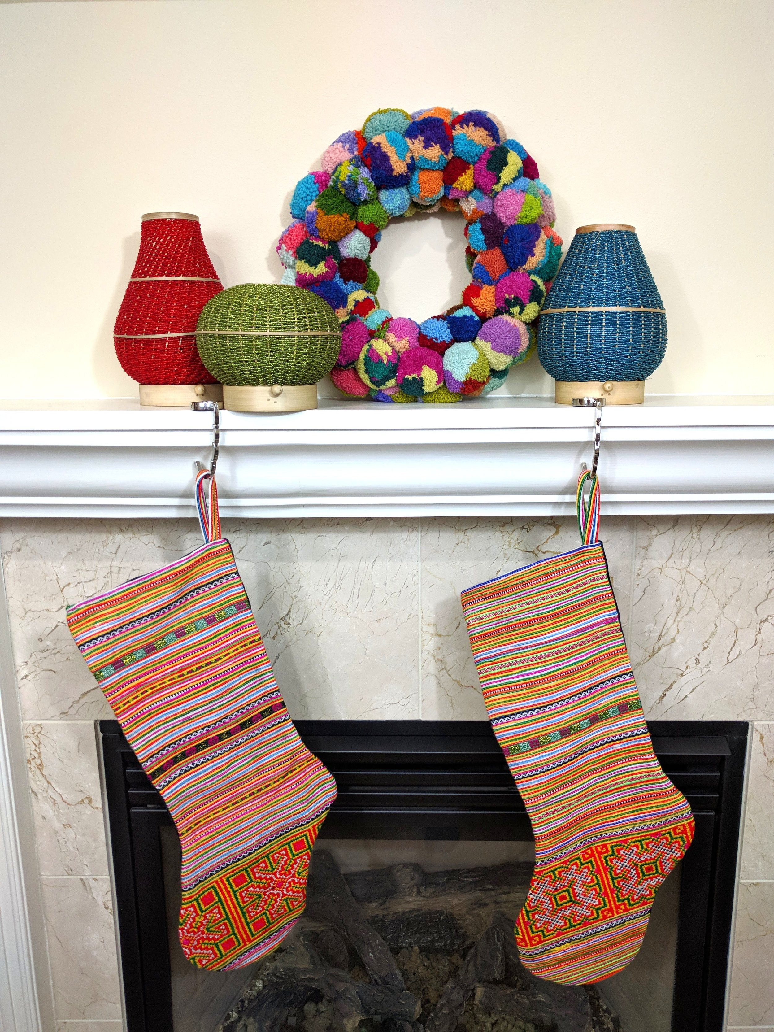 Authentic Hmong fabric is handcrafted into a fair trade stocking from Vietnam that tells a story of culture and craft.