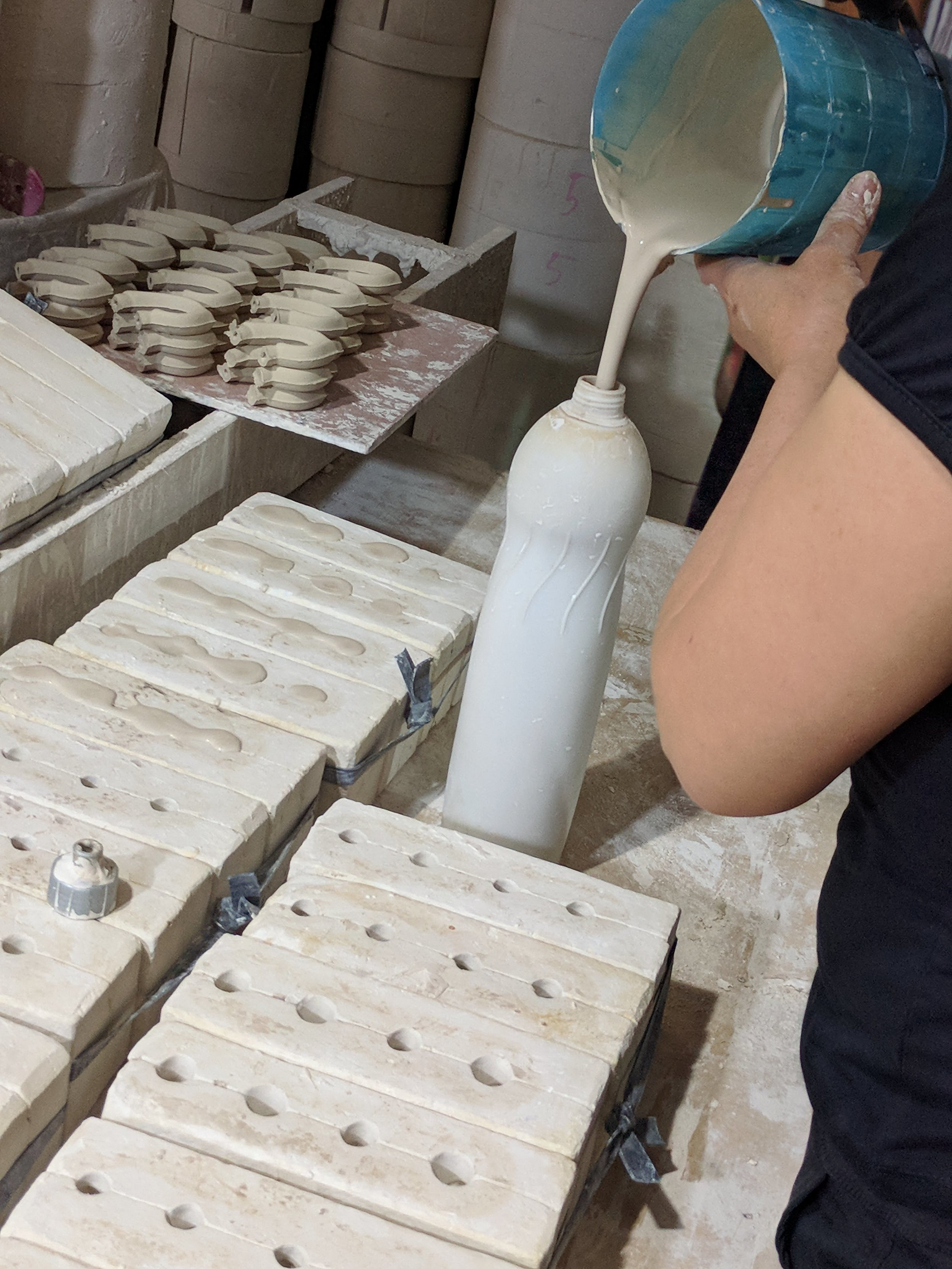 To create a piece using a mold, the wet mixture is poured into a bottle for easy dispensing