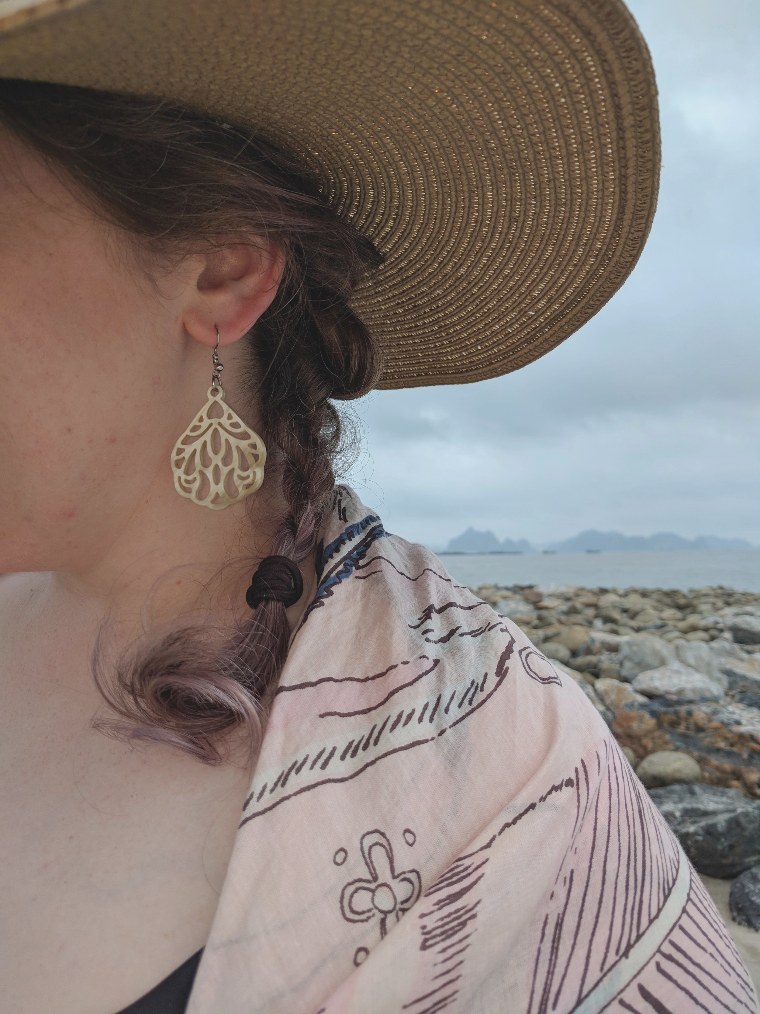 Calypso Earrings, Songbird Scarf, massive hat, swimsuit, breathtaking views of Ha Long Bay.