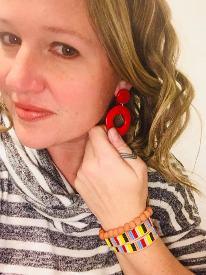 "Lindy Zepp says, ""I sometimes skip a necklace (especially with a neckline like this) and do statement earrings and an arm party."" The Orbital Earrings look awesome with the color blocking of the Banded Beads Wrap Bracelet and Terracotta Tassel Bracelet."