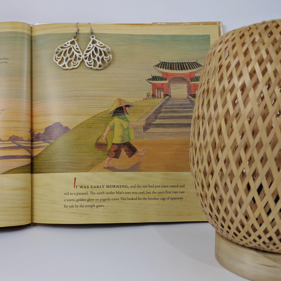 Diverse children's books that connect kids to countries around the globe, featuring Noonday Collection's partner countries. Pictured: Fly Free by Roseanne Thong and Eujin Kim Neilan, set in Vietnam. #noondayambassador #childrenslit #kidslit #diversebooks
