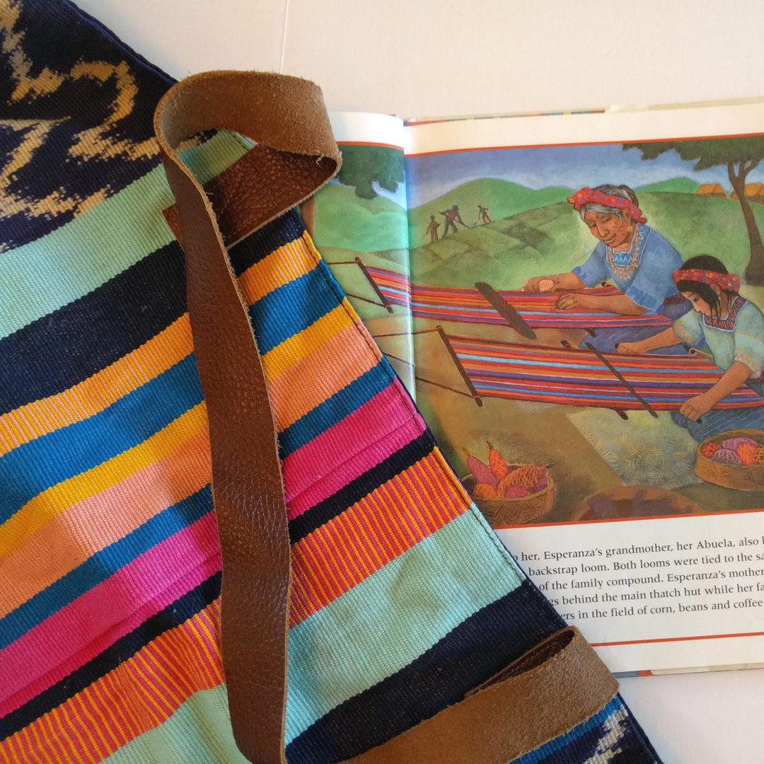 Diverse children's books that connect kids to countries around the globe, featuring Noonday Collection's partner countries. Pictured: Abuela's Weave, about backstrap loom textiles in Guatemala. #noondayambassador #childrenslit #kidslit #diversebooks