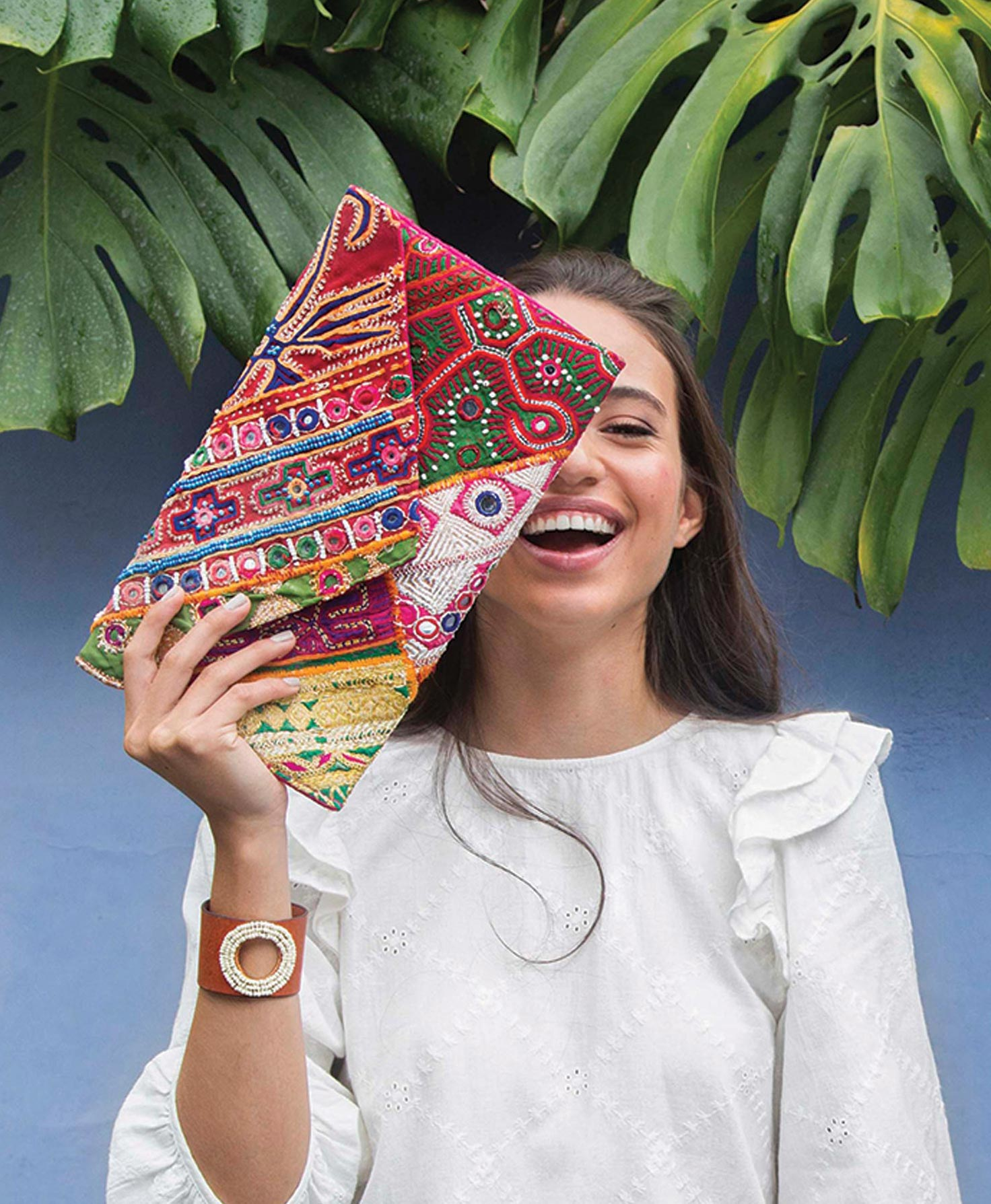 The Paradise Pouch, ethically made in India, is made of upcycled saris. Each is one of a kind. From fair trade fashion brand Noonday Collection.