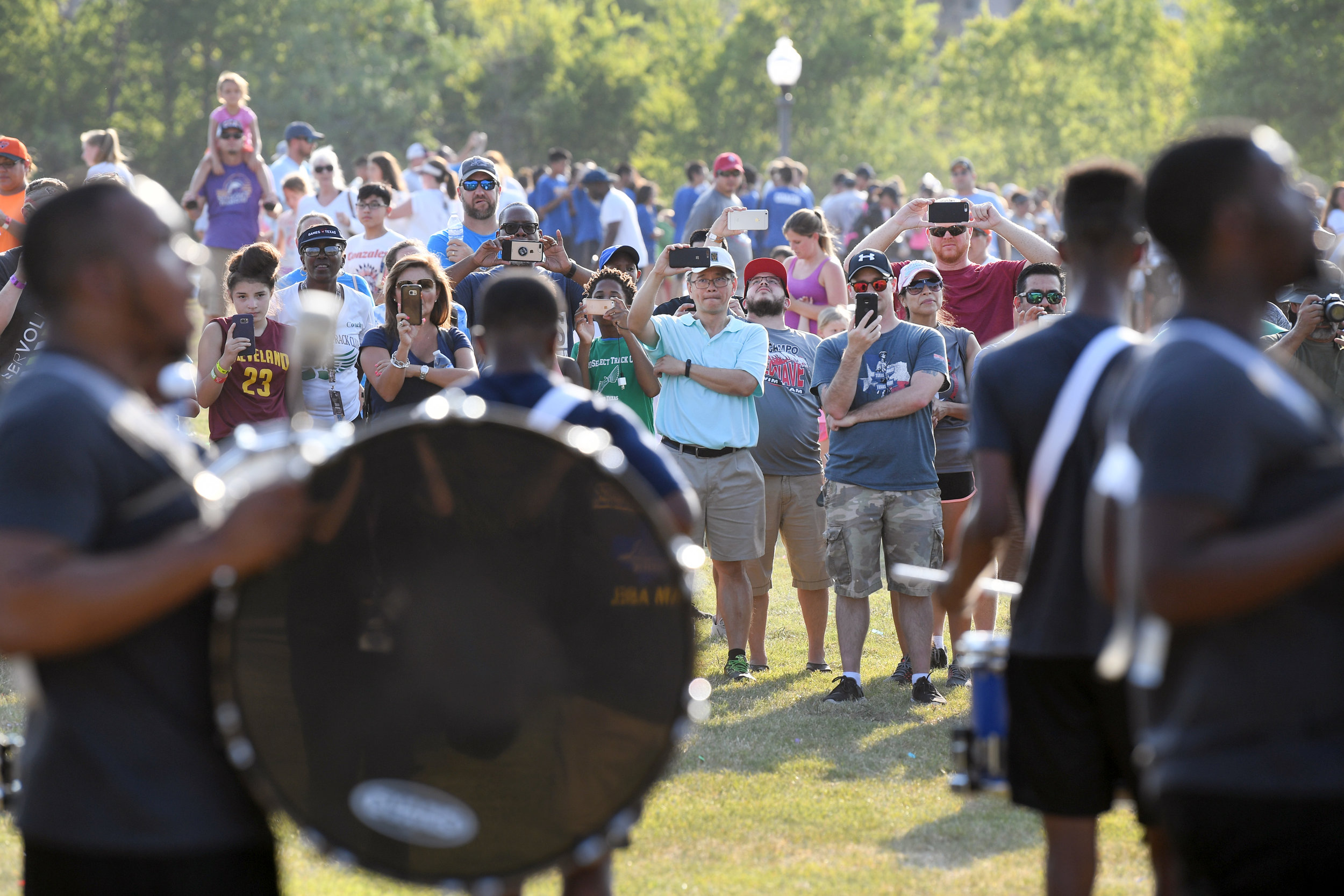 Spectators watch as the drum line from Prairie View A&M University lead athletes in a parade around Wolf Pen Creek Park during the opening ceremonies for the Games of Texas on Friday, July 27, 2018. (Laura McKenzie/The Eagle)