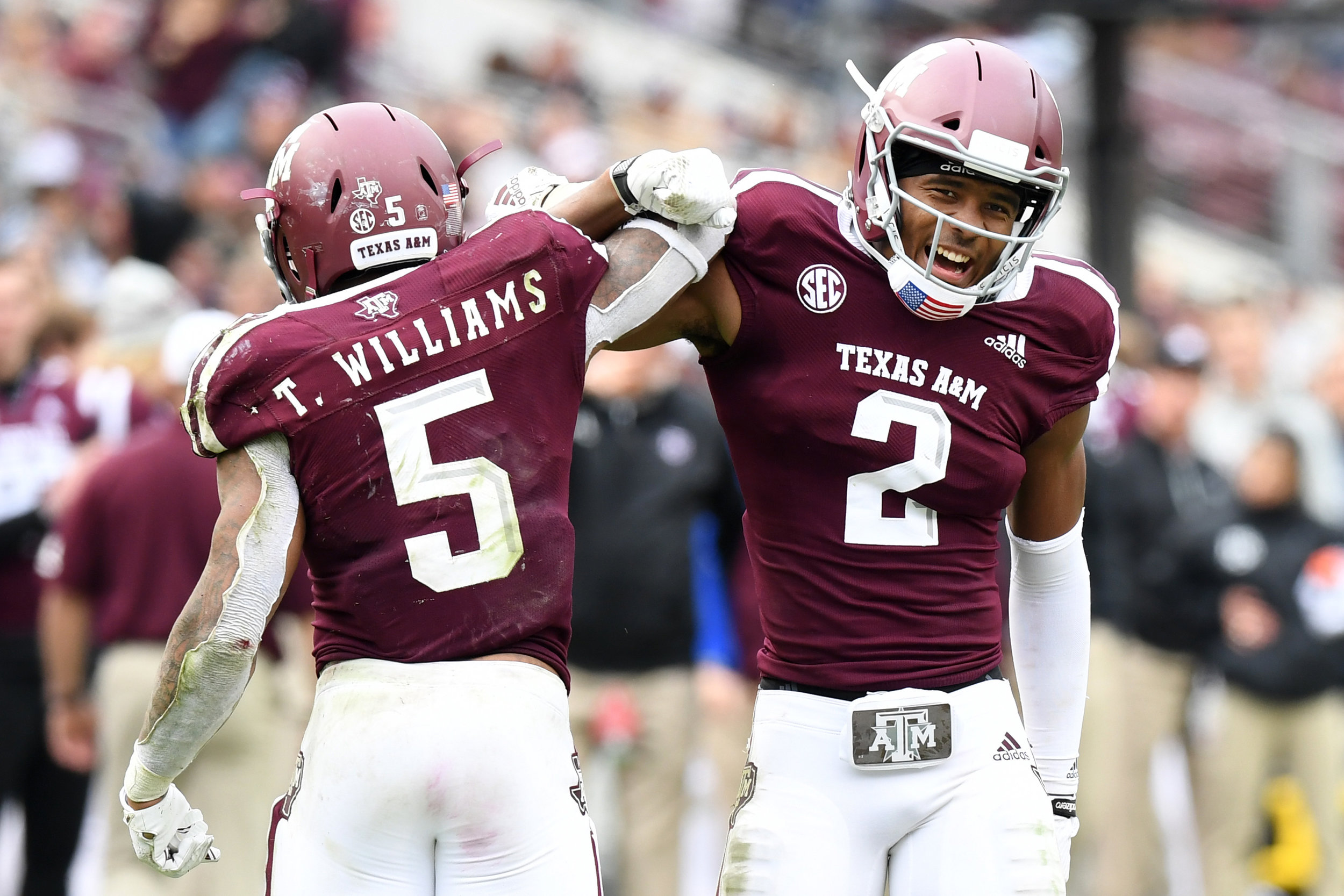 Texas A&M's Trayveon Wiliams (5) and Jhamon Ausbon (2) celebrate following a play in the fourth quarter against Ole Miss on Saturday, Nov. 10, 2018, at Kyle Field in College Station, Texas. (Laura McKenzie/The Eagle)