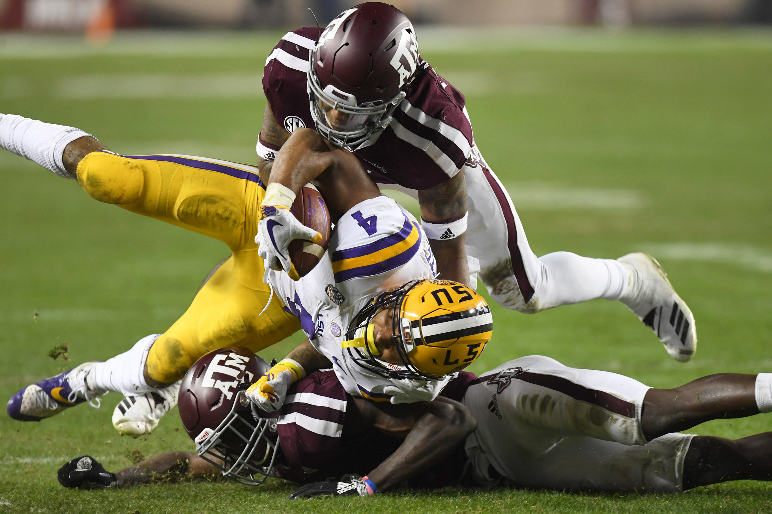 Texas A&M's Larry Pryor (11) and Debione Renfro (29) stop LSU's Nick Brossette (4) in the third quarter Saturday, Nov. 24, 2018, in College Station, Texas. (Laura McKenzie/The Eagle)