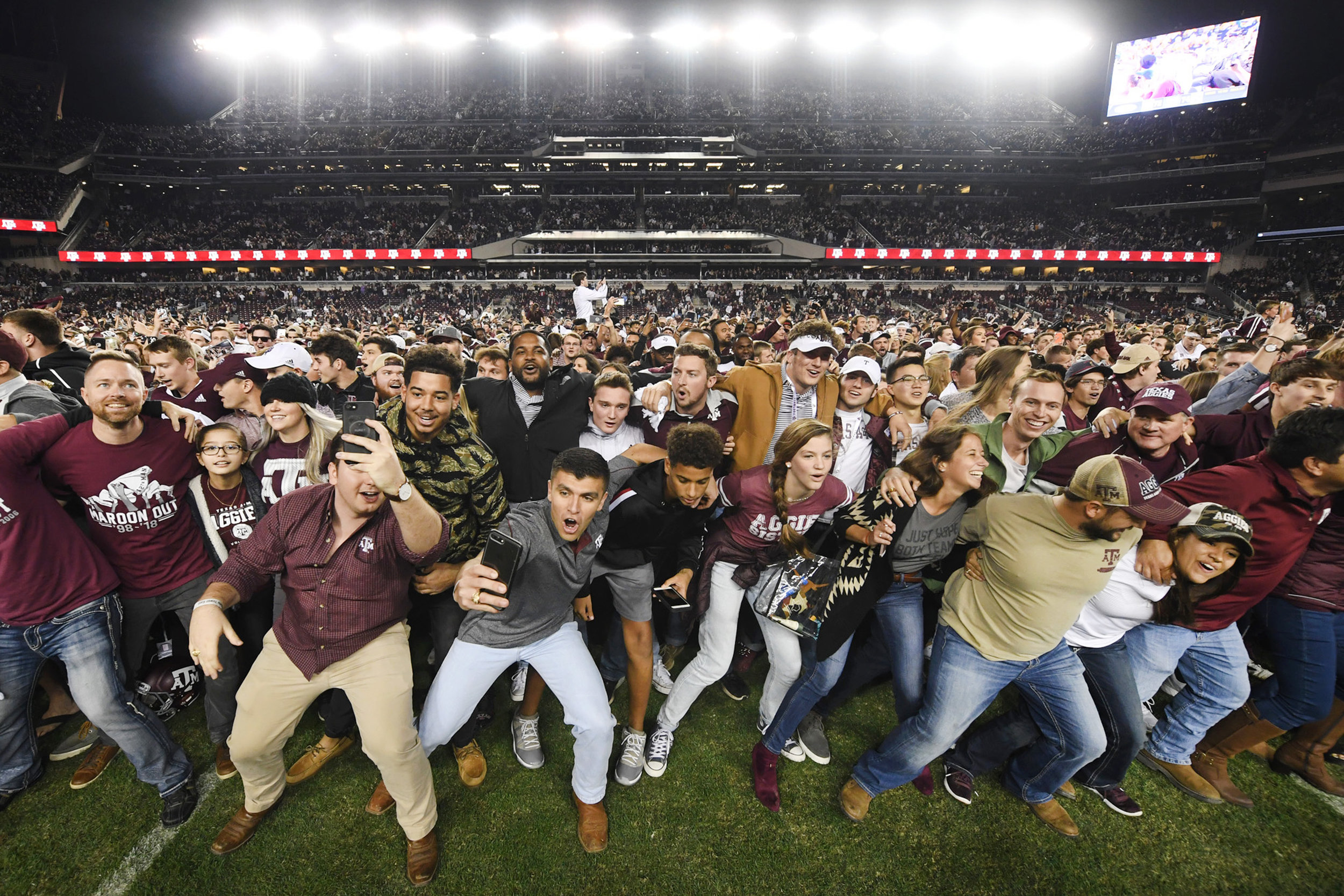 Fans storm the field as the Aggies celebrate their win in the seventh overtime against LSU at Kyle Field on Saturday, Nov. 24, 2018, in College Station, Texas. (Laura McKenzie/The Eagle)