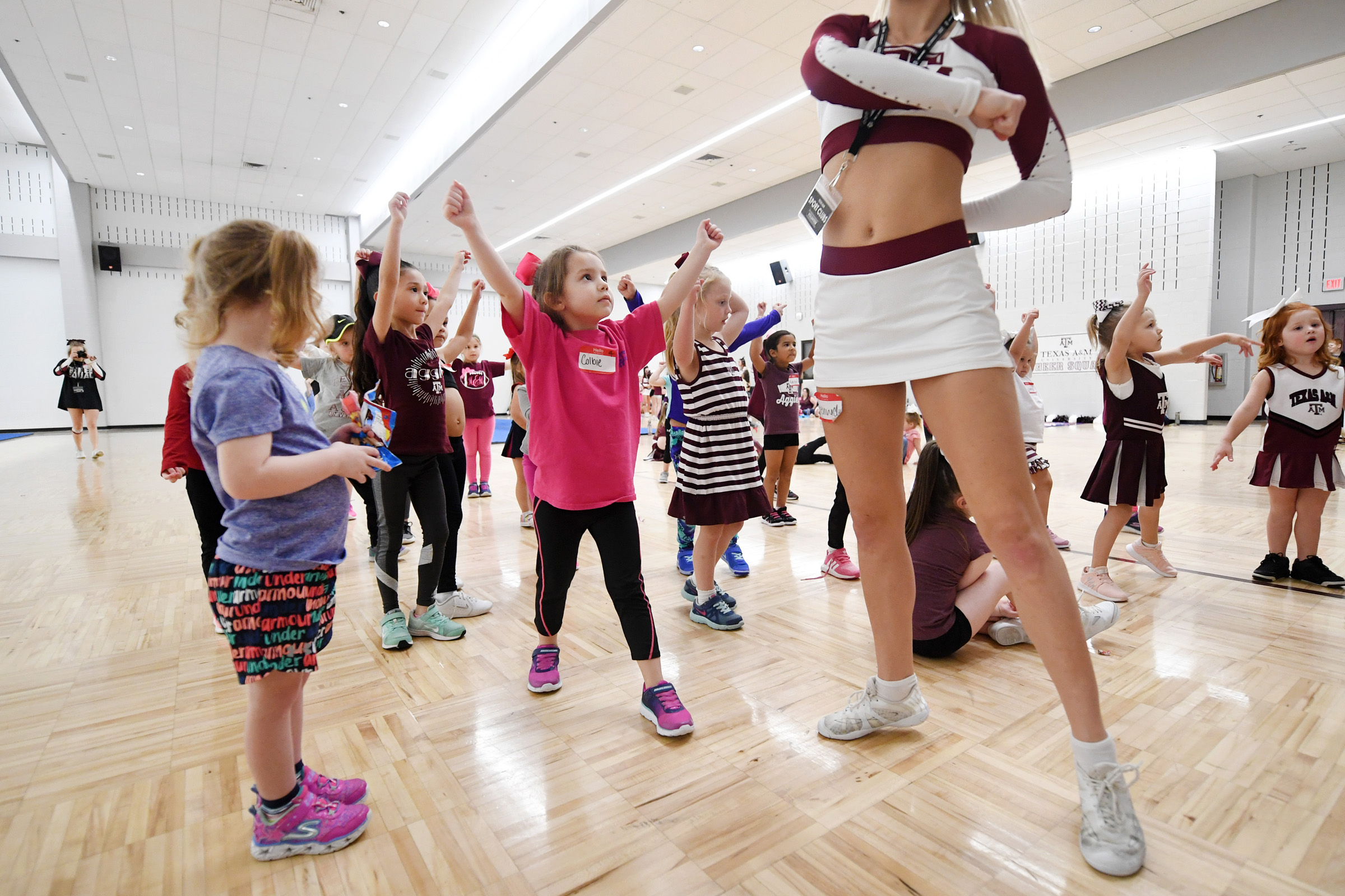 The Texas A&M Cheer Squad hosts a clinic for children ages 3-14 at the Student Recreation Center on Saturday, Jan. 19, 2019, in College Station, Texas. Participants played games, learned cheers and practiced jumps and tumbling skills. (Laura McKenzie/The Eagle)