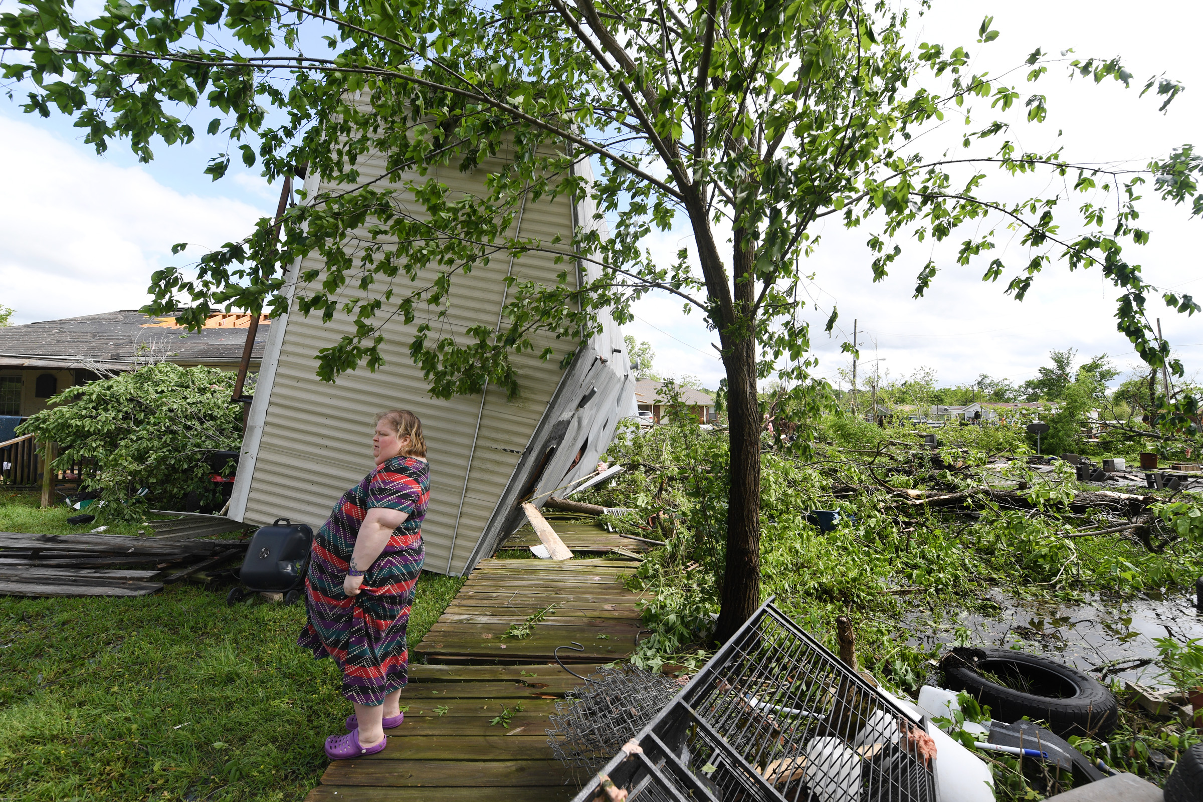 Angel Funk stands in the backyard of her Franklin, Texas, home following severe weather Saturday, April 13, 2019. Funk's house was struck by her neighbor's mobile home, but she and her husband, who were home at the time, escaped unharmed. (Laura McKenzie/The Eagle)