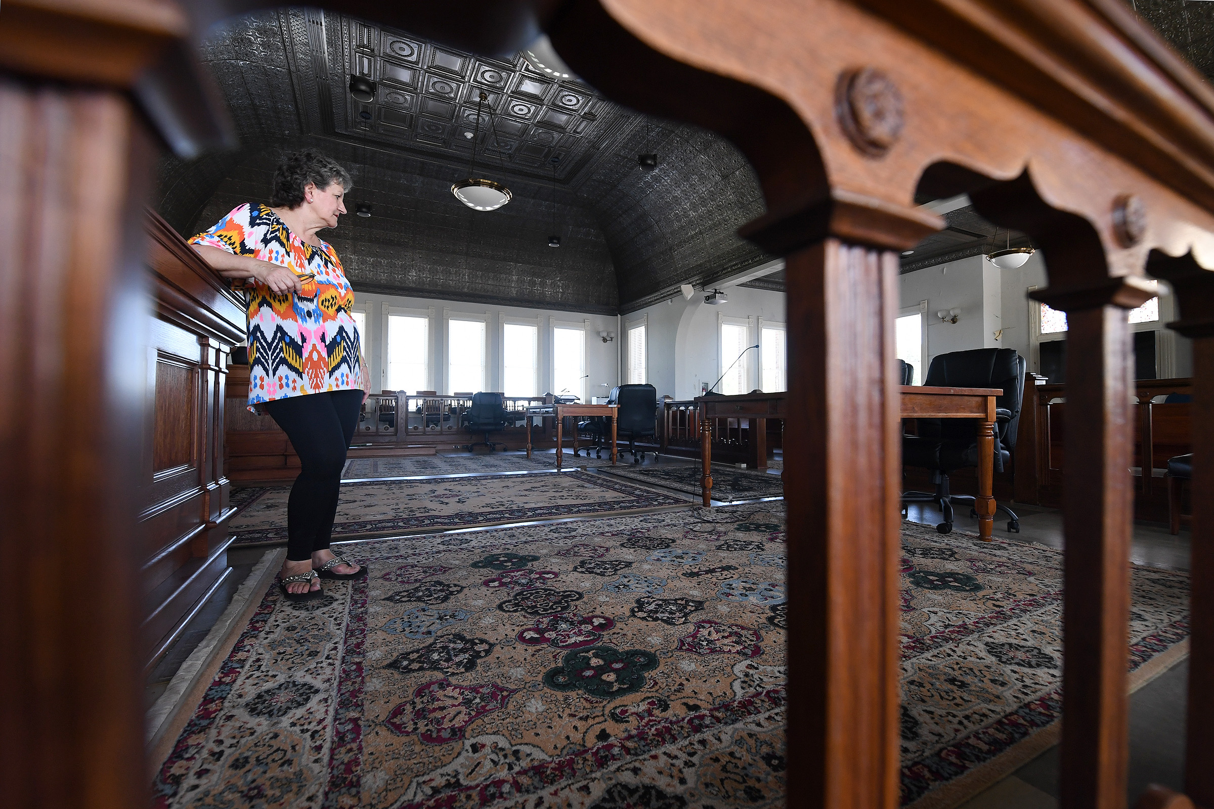 Former Mayor Gail Sowell stands in the courtroom at the Grimes County Courthouse on Thursday, June 13, 2019 ahead of a community event celebrating the courthouse's 125th anniversary in Anderson, Texas. (Laura McKenzie/The Eagle)