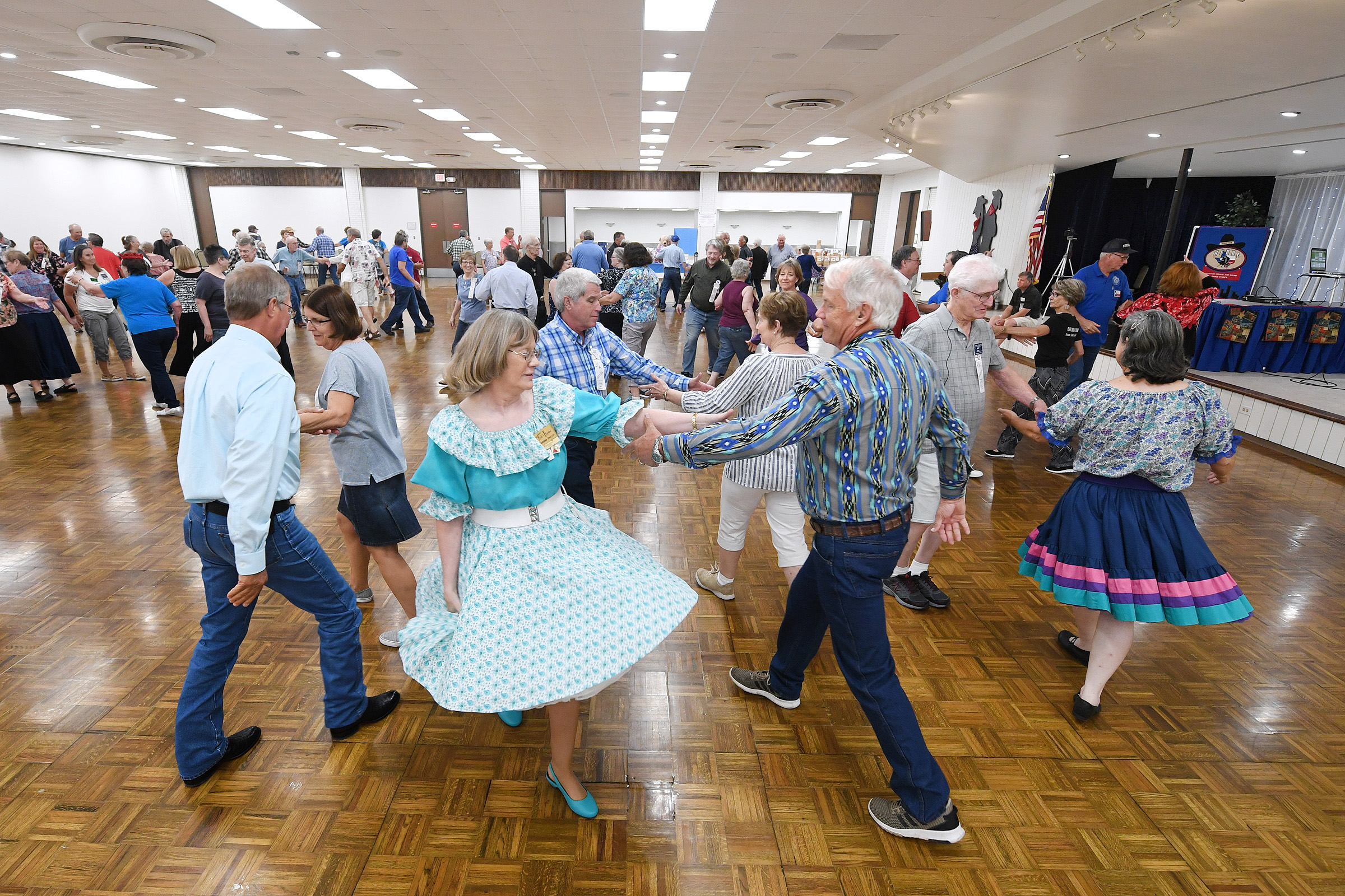 "Couples dance inside the Brazos Center as they participate in ""Calls that Trouble Me,"" a workshop for attendees of the 57th annual Texas State Square and Round Dance Festival on Friday, June, 14, 2019, in Bryan, Texas. (Laura McKenzie/The Eagle)"