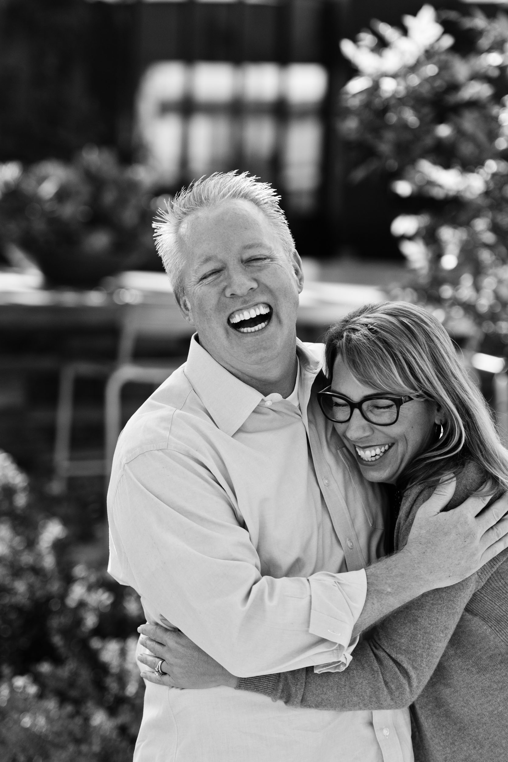 Dad and mom hugging and laughing. Beacon Park in Irvine, California.