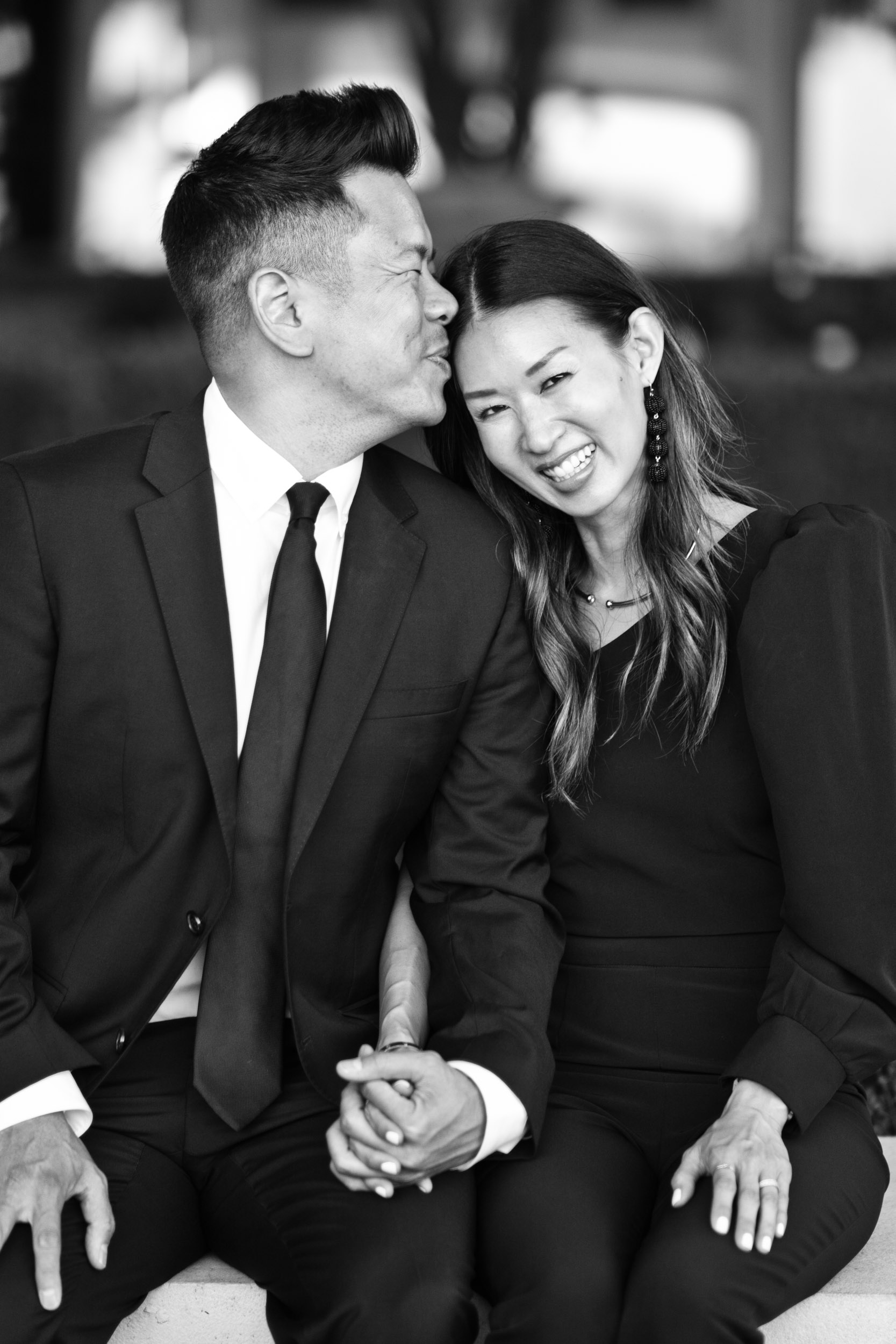 Dad and mom holding hands and smiling at Pelican Hill Resort in Newport Beach, California. Christine Kong of Daily Kongfidence.