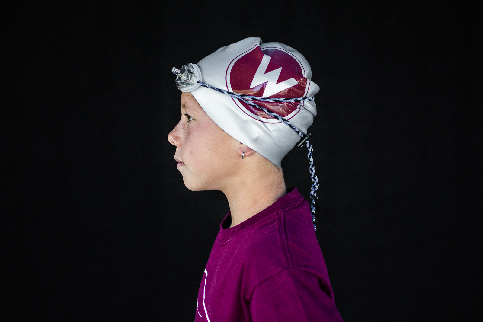 profile of girl swimmer with goggles and swim cap