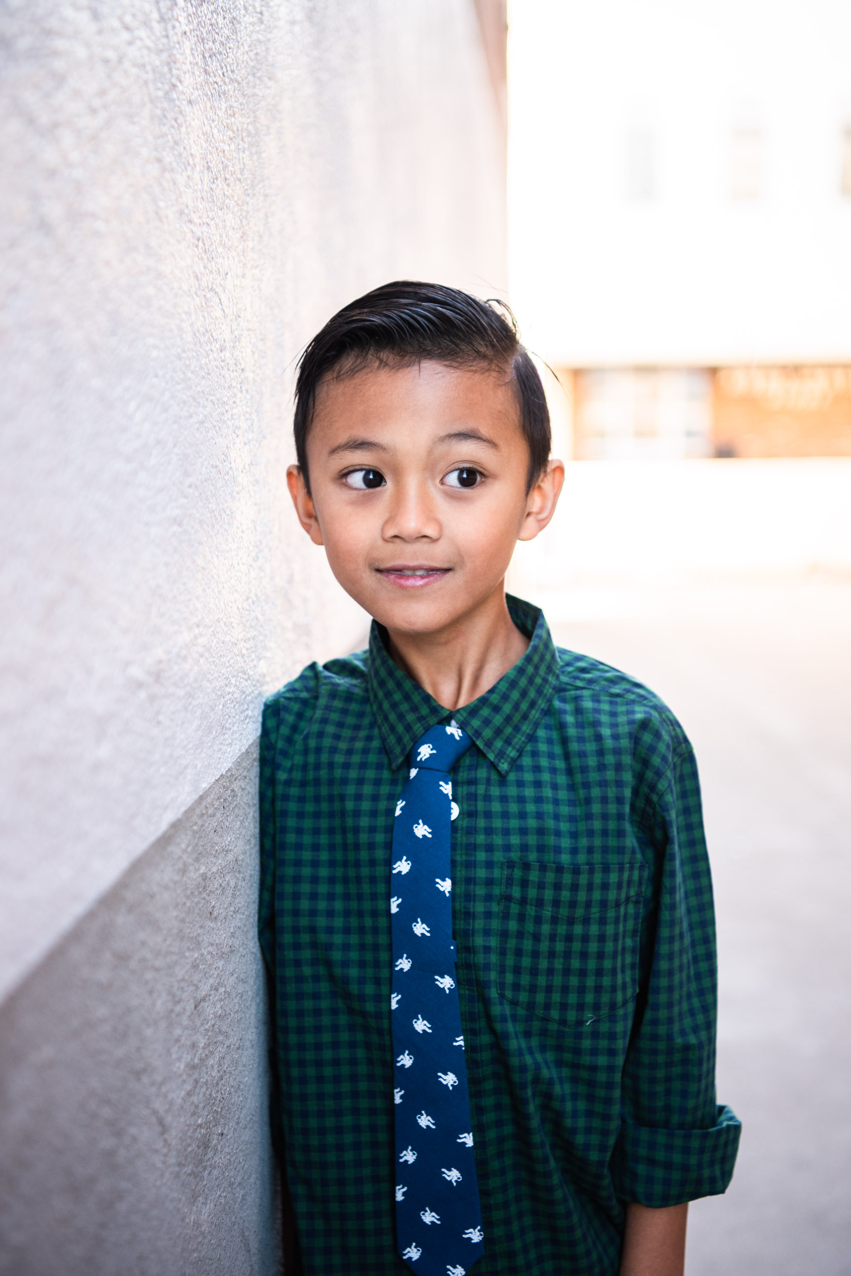 Lisa Hu Chen orange county family photographer | young boy wearing a tie standing in the alleyway off Chapman Avenue in Old Town Orange