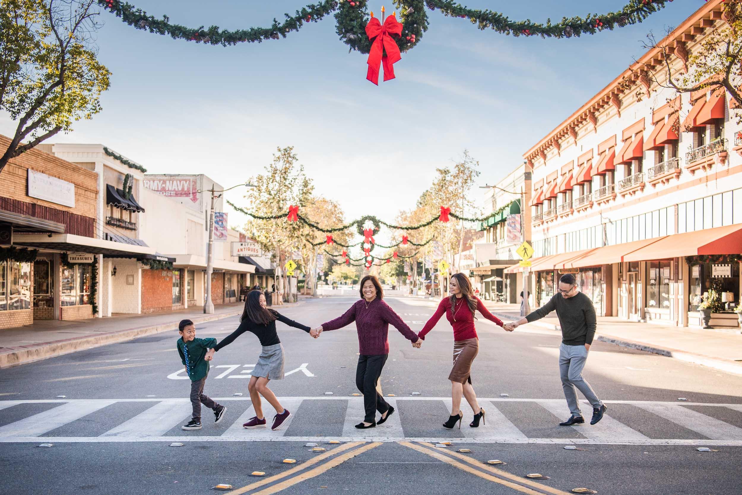 Lisa Hu Chen orange county family photographer | family walking across Chapman Avenue in Old Town Orange