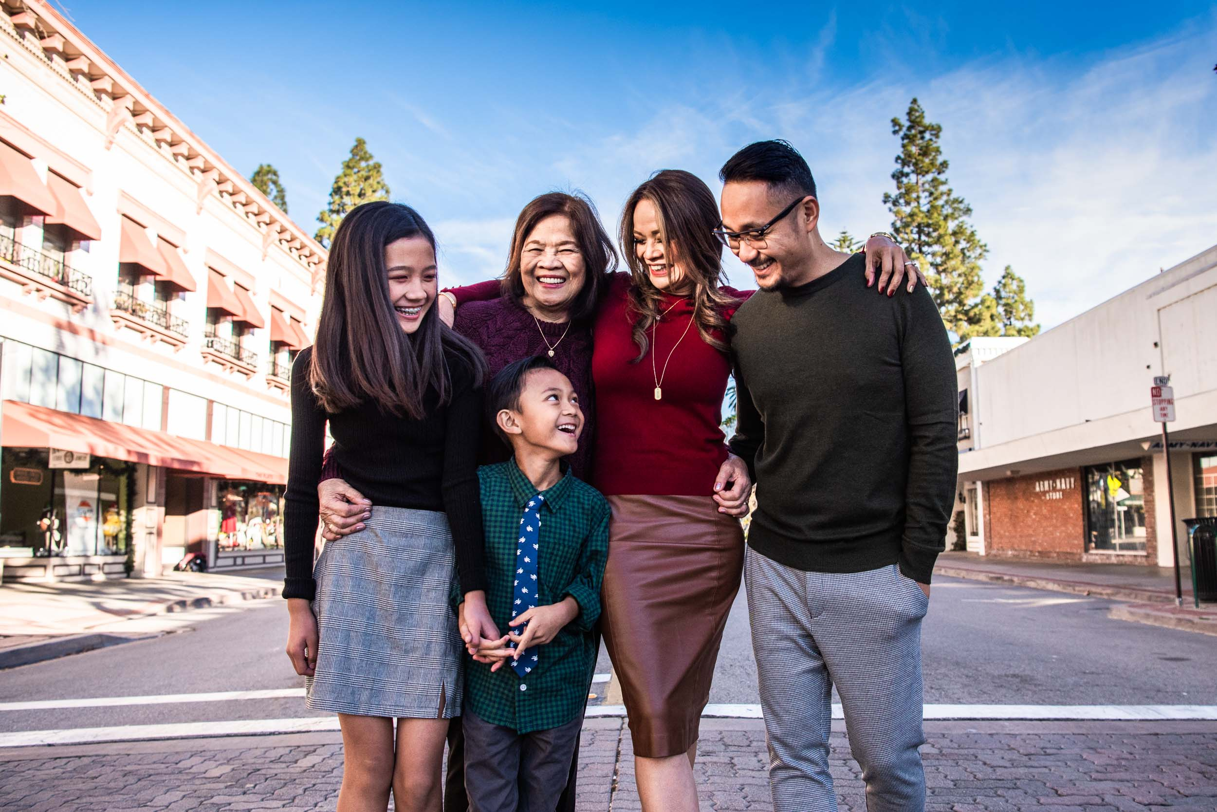Lisa Hu Chen orange county family photographer | family laughing and hugging in the middle of Chapman Avenue in Old Town Orange