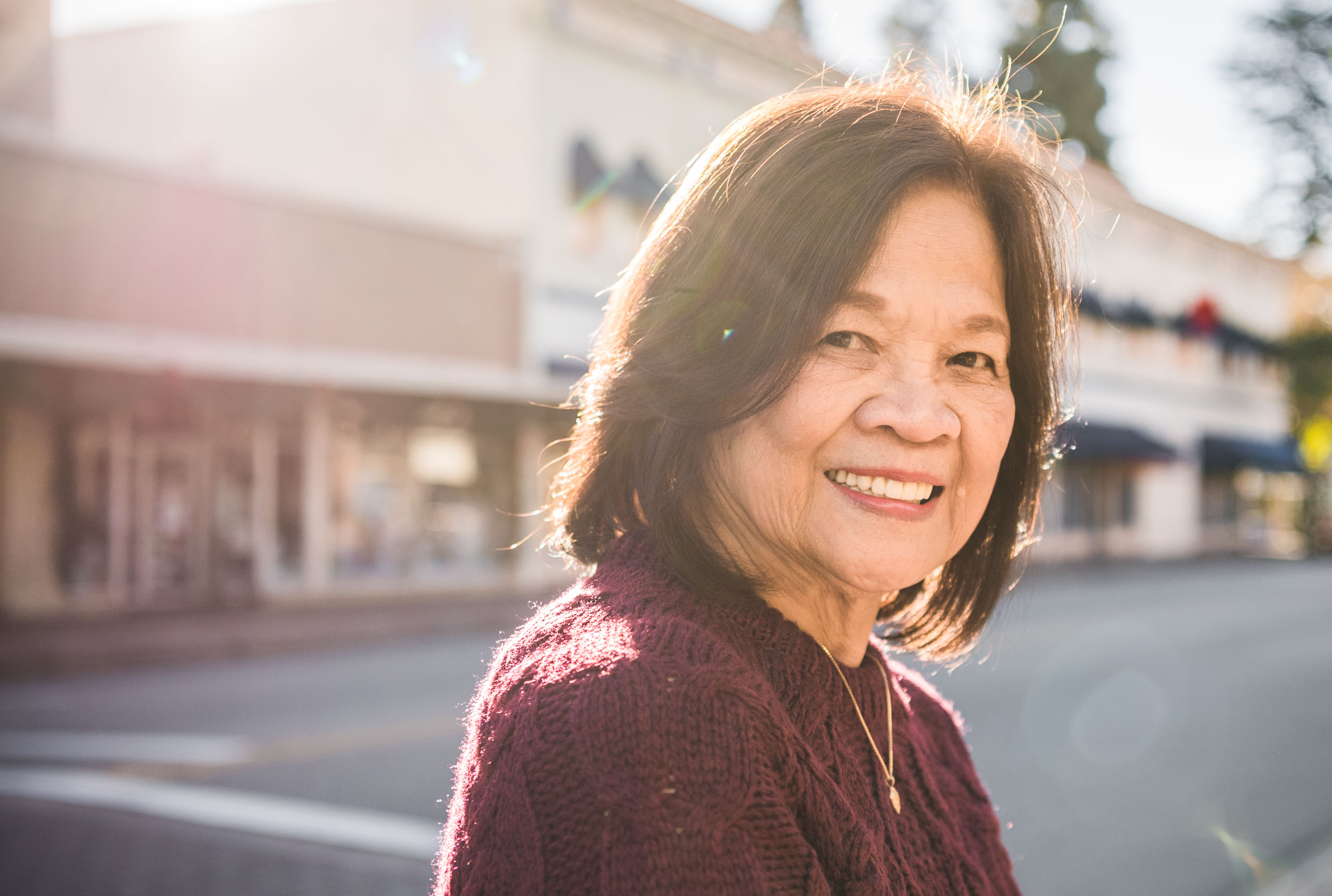 Lisa Hu Chen orange county family photographer | grandma standing and smiling in the streets of Old Town Orange