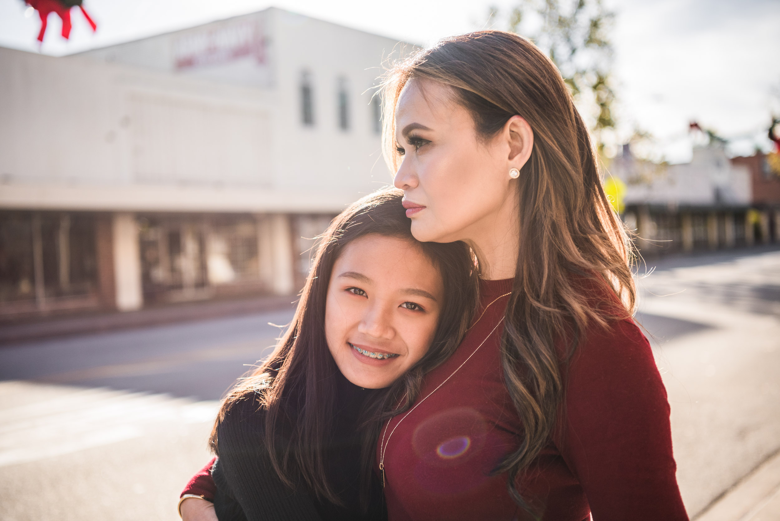Lisa Hu Chen | mom holding her daughter while standing in the middle of the street in Old Town Orange