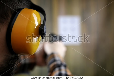 stock-photo-bearded-man-with-put-on-protective-goggles-and-ear-training-in-pistol-shooting-543692032.jpg