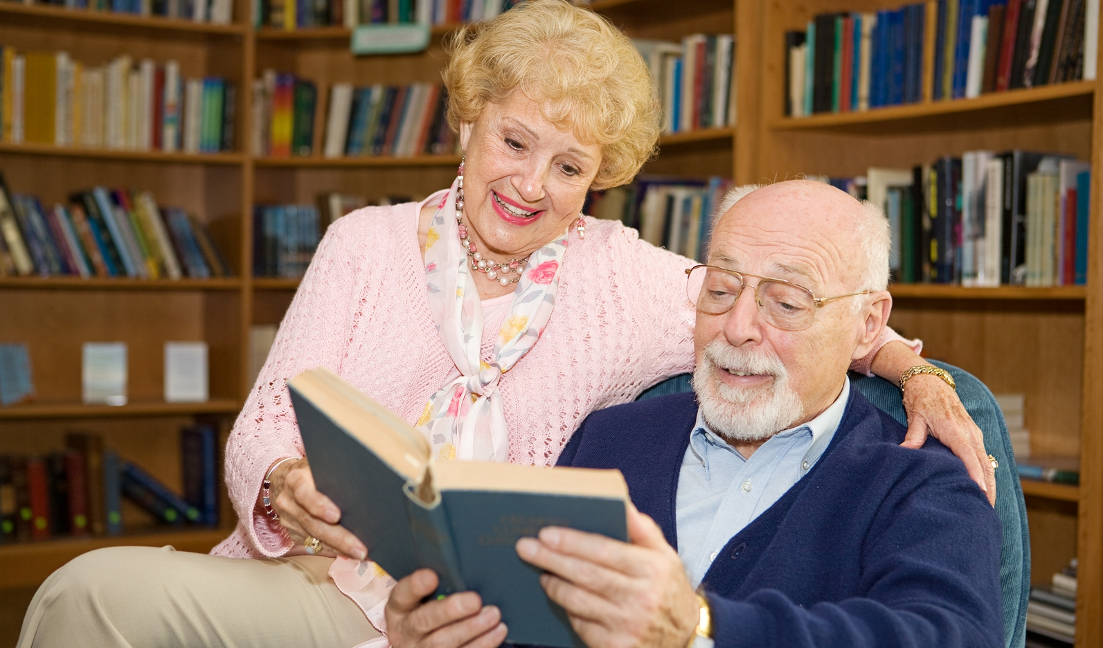 Bigstock-44582165-Senior-couple-enjoying-a-good-book-together-in-the-library..jpg