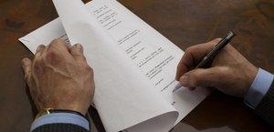 man-signing-letter.jpg