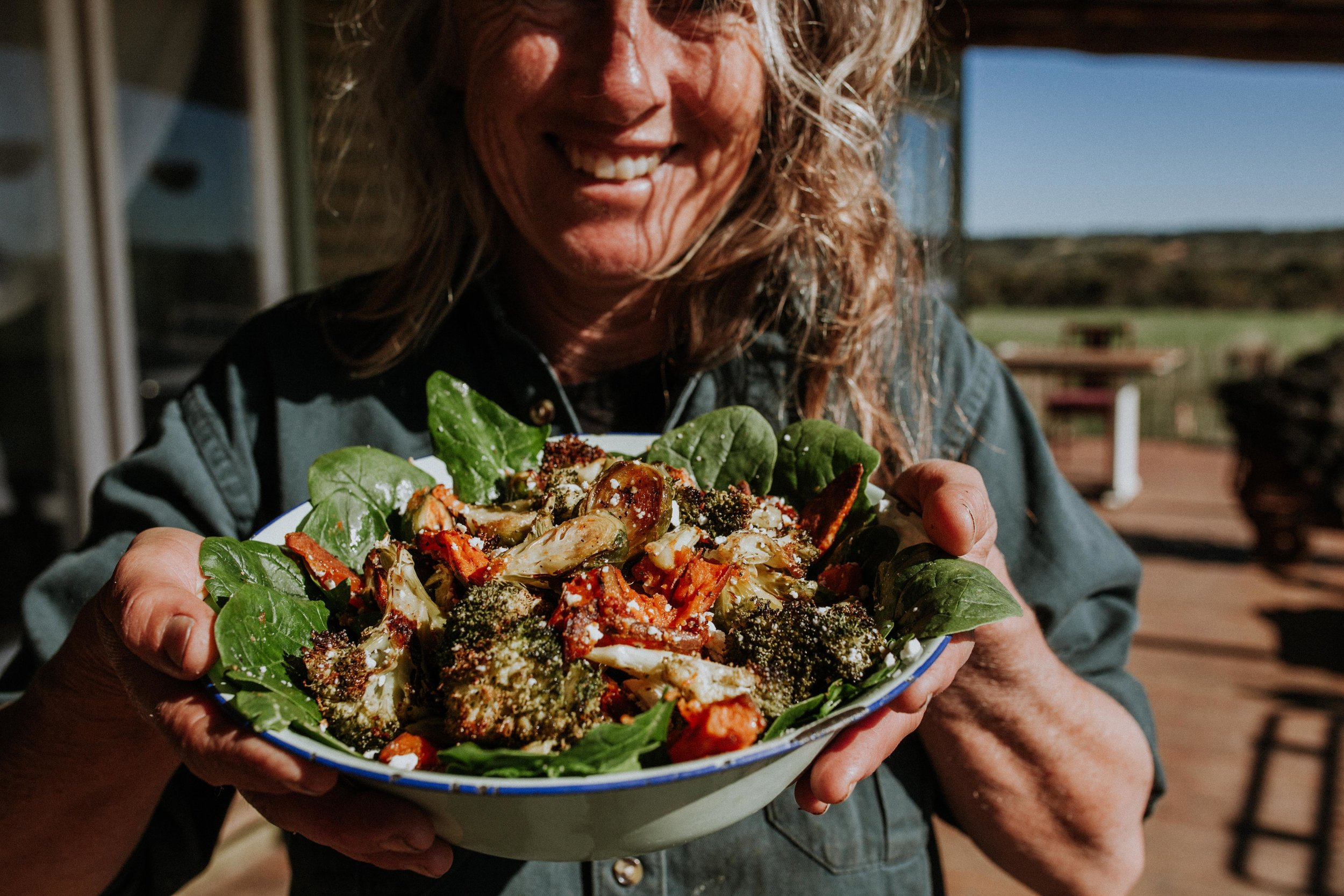 Dorothy Henderson pictured here with the warm winter veggie salad in all it's glory!