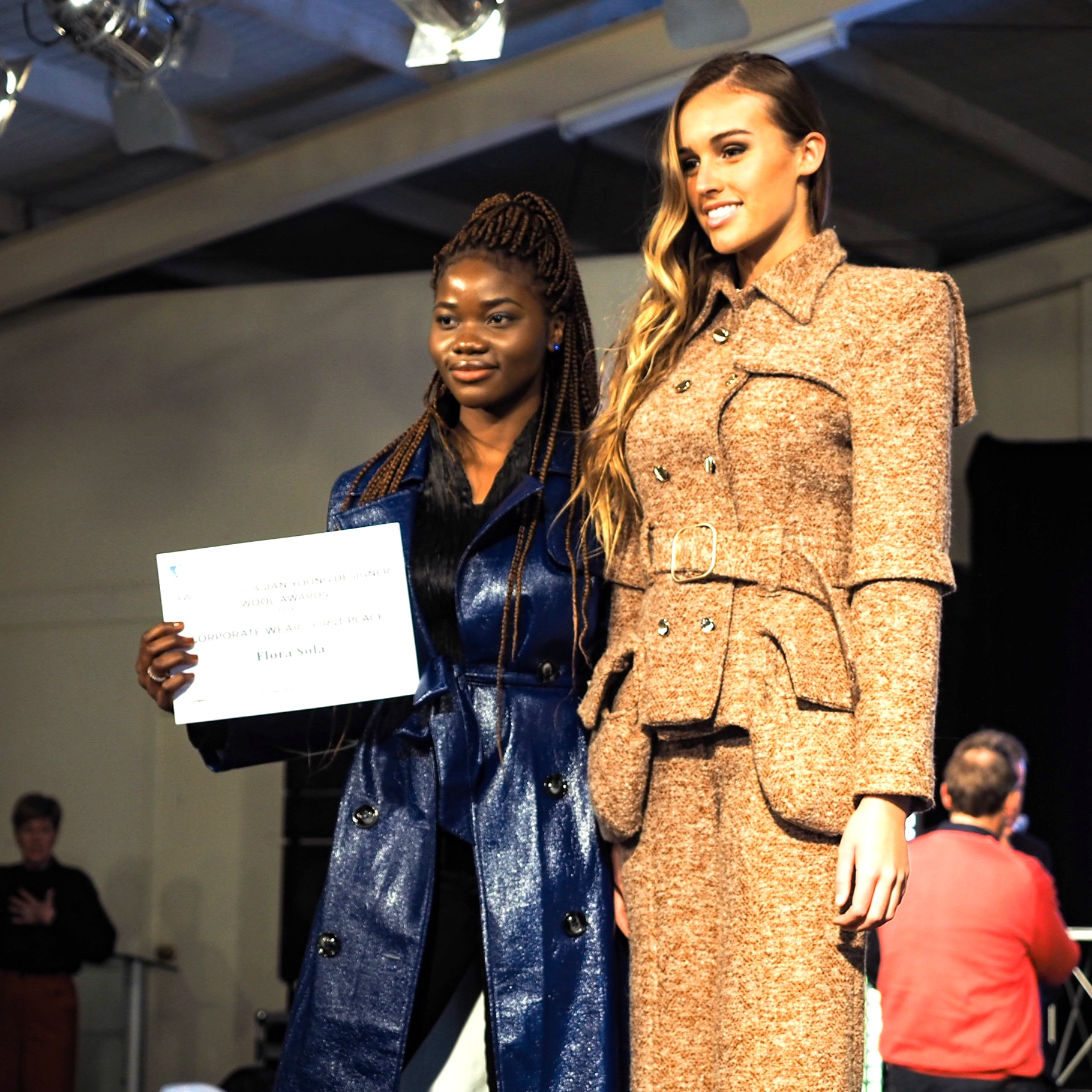 Flora Sola with her first place Corporate Wear design