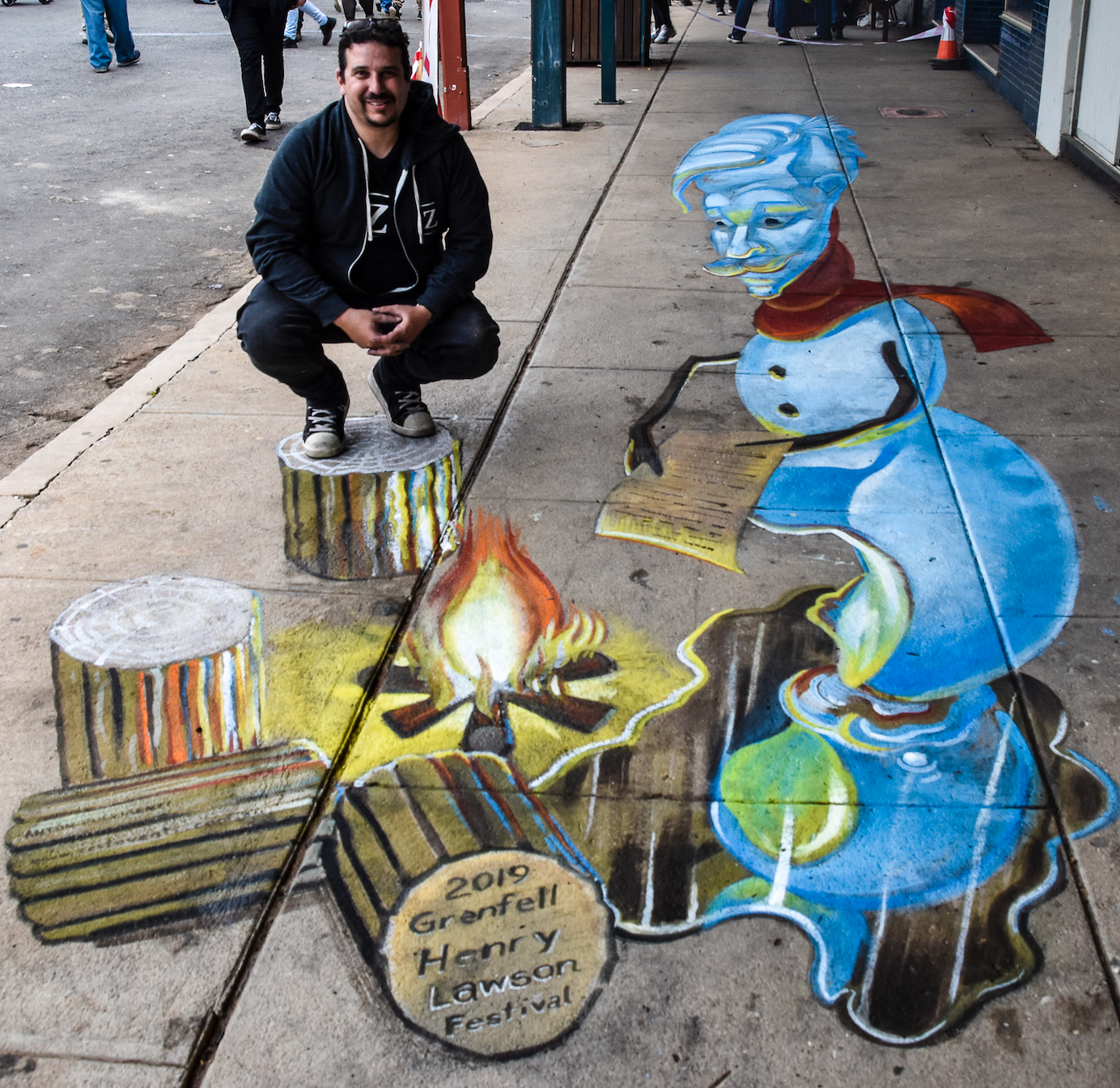 Chalk artist, Anton Pulvirenti, with his brilliant blue snowman