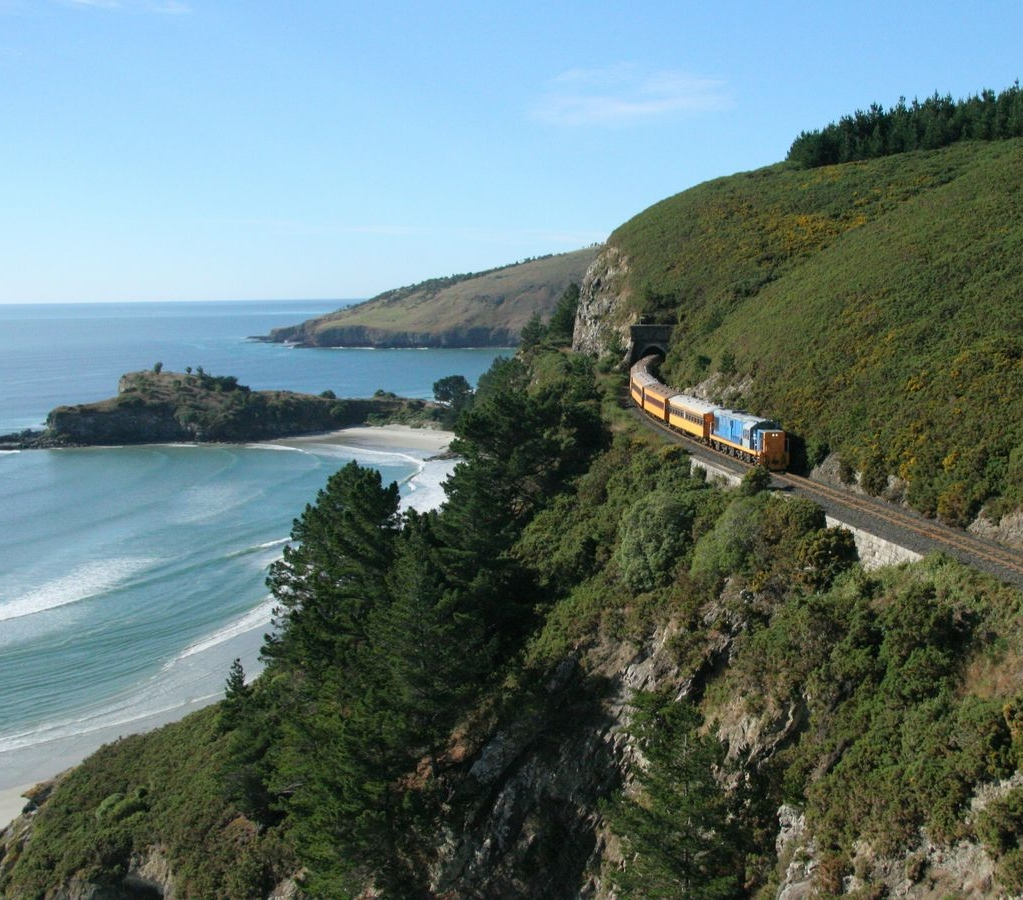 Train Logistics - VENUE: Private Charter of Dunedin Railways Seasider Clifftop Spectacular (return from Dunedin to Waikouaiti) with disembarkation at the former Seacliff Lunatic Asylum site, heritage-rich Port Chalmers and a secret third location...PLAYERS: the train can accommodate 30-200 players including those with restricted mobility.DURATION: 2.5 hours to complete the 49 km journey from Waikouaiti to Dunedin Railway Station. (The first leg of the journey to Waikouaiti is an hour's relaxed sightseeing).FLEXIBILITY: Can be integrated into an entire conference day including dining and formalities in Waikouaiti, Port Chalmers or Dunedin.