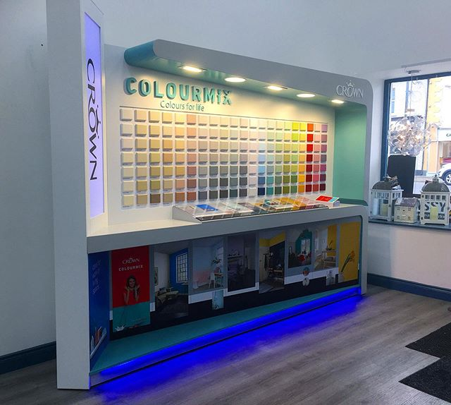 A stunning color block display stand designed and manufactured in-house by our team.  The stand boasts 147 individually painted blocks, LED lighting features and clean curves in its design.  #paint #design #manufacture #install #retail #shopfitting #bespokeretailsolutions #bespoke #ledlights #shopfittingireland #alliedretail #manufacturing