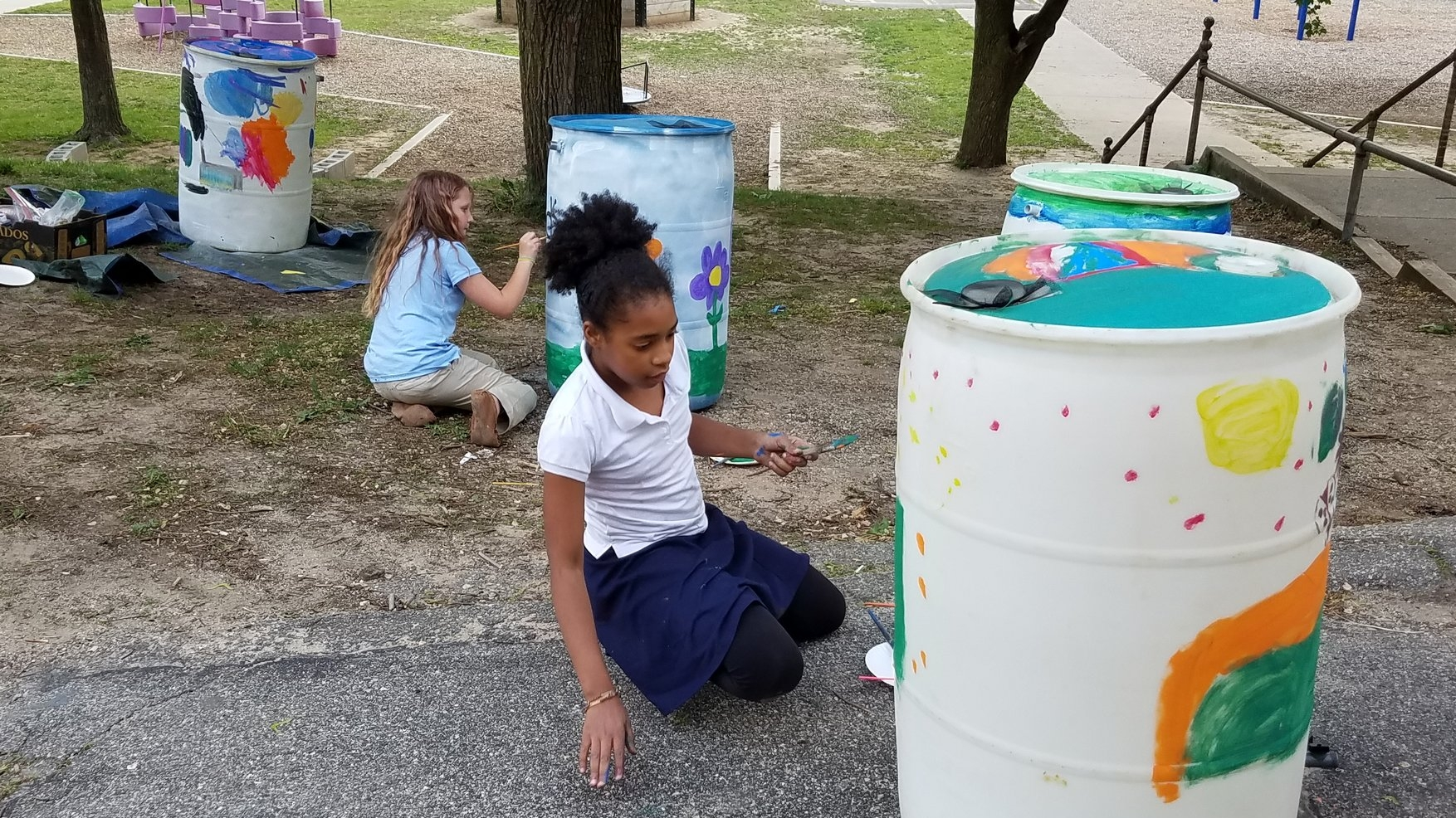 North Park Elementary students painting rain barrels at the GLRI Rain Barrel Workshop May 2017