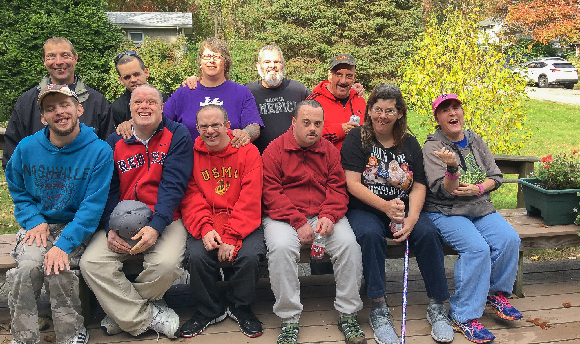 "Julie and Dennis Barratt with nine of the home's twelve residents. To see everyone click on  ""Meet the Residents"""