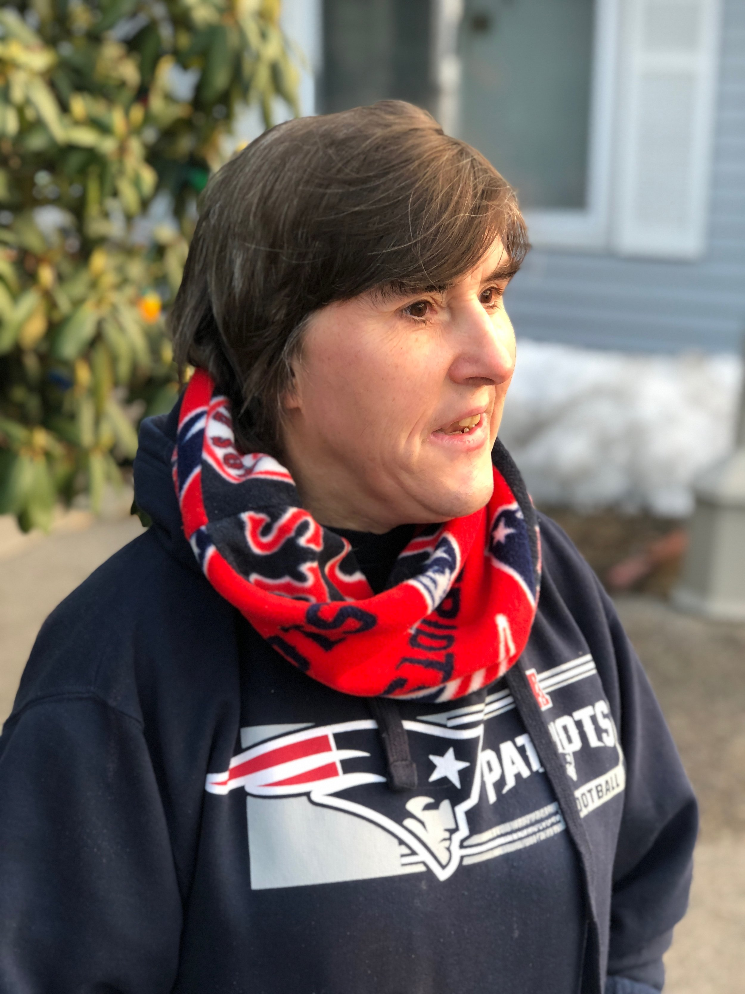 Nancy modeling her new Patriots scarf right before a big game.