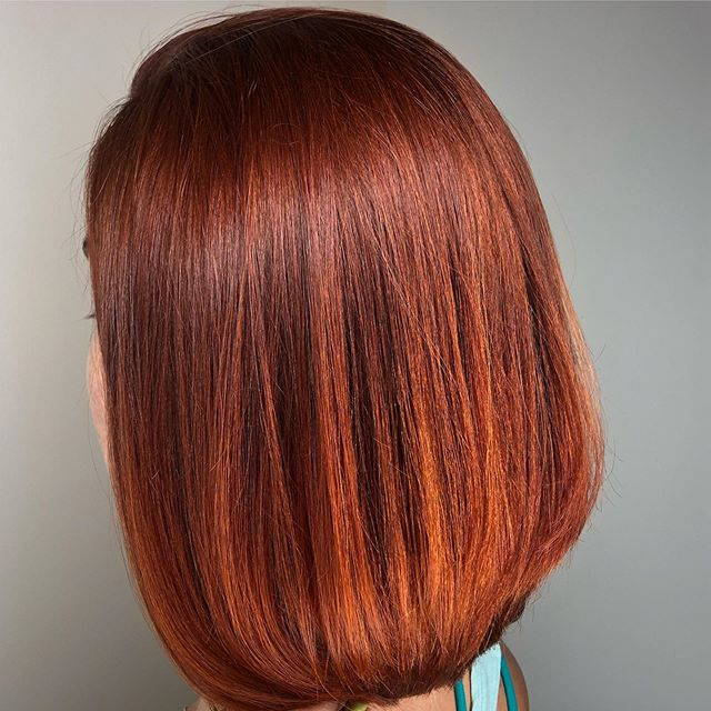 There are no words for color this beautiful! Amazing red creation by Jade at @moore_hairdesign Call and get booked soon if you're wanting to get in before the school year starts! #moorehairdesign #redhaircolor #saltlakesalon #utahhairsalon