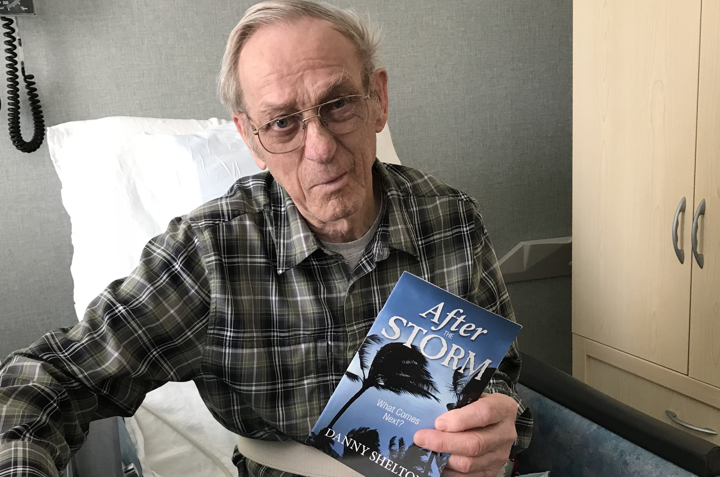 Fred Buchholz, a Deacon the Raymond Seventh-day Adventist Church,at the hospital with tract in hand.